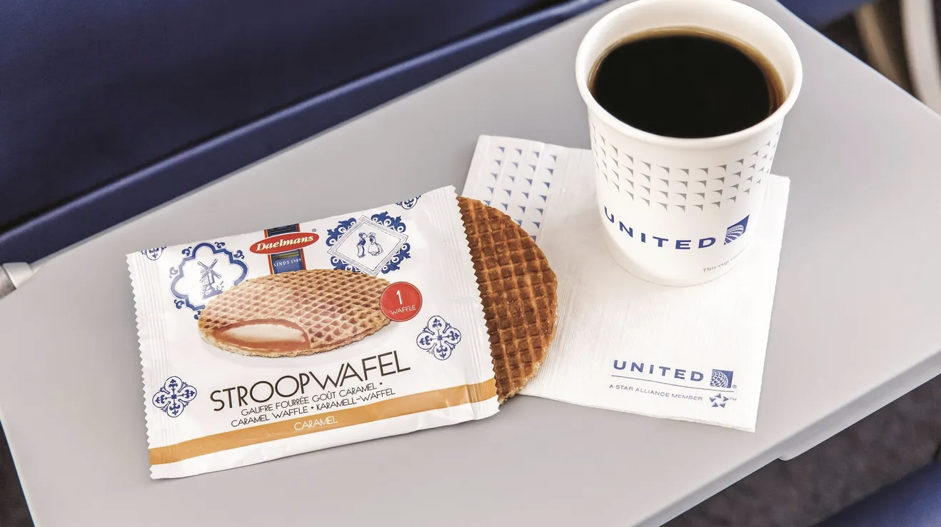 stroopwafel and coffee on a tray table.