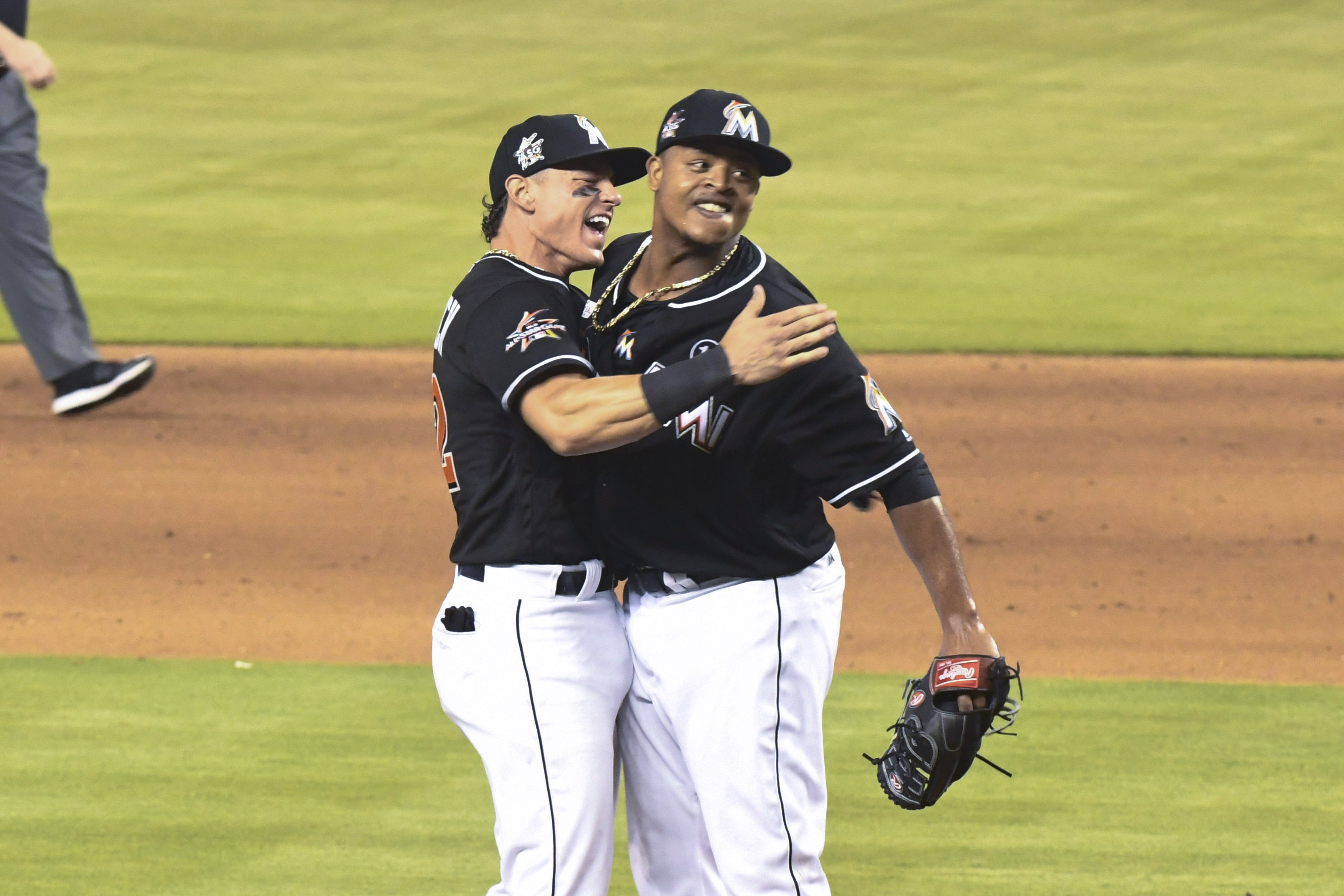 Edinson Volquez #36 of the Miami Marlins celebrates with Derek Dietrich #32 after throwing a no hitter against the Arizona Diamondbacks at Marlins Park on June 3, 2017