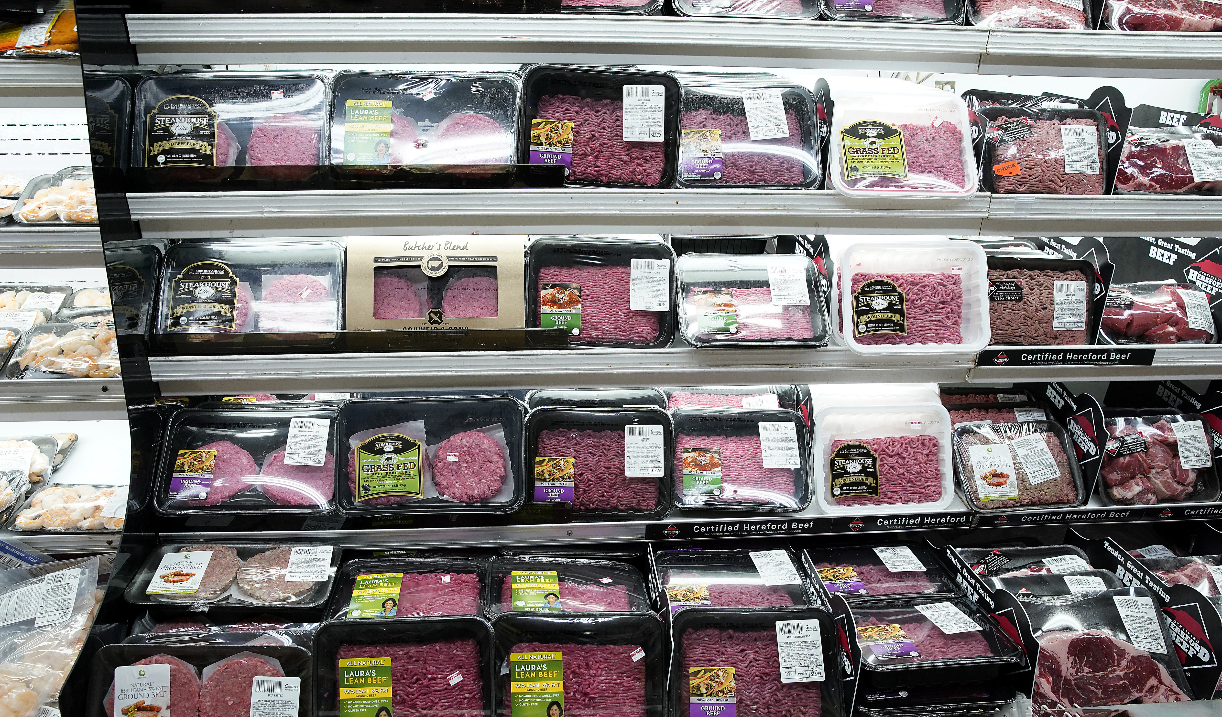 Packages of various meats are seen in a supermarket...