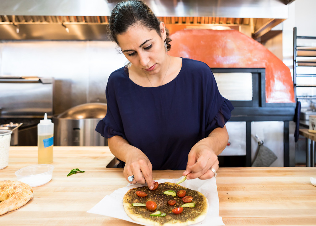 Reem Assil in the kitchen of her Fruitvale restaurant