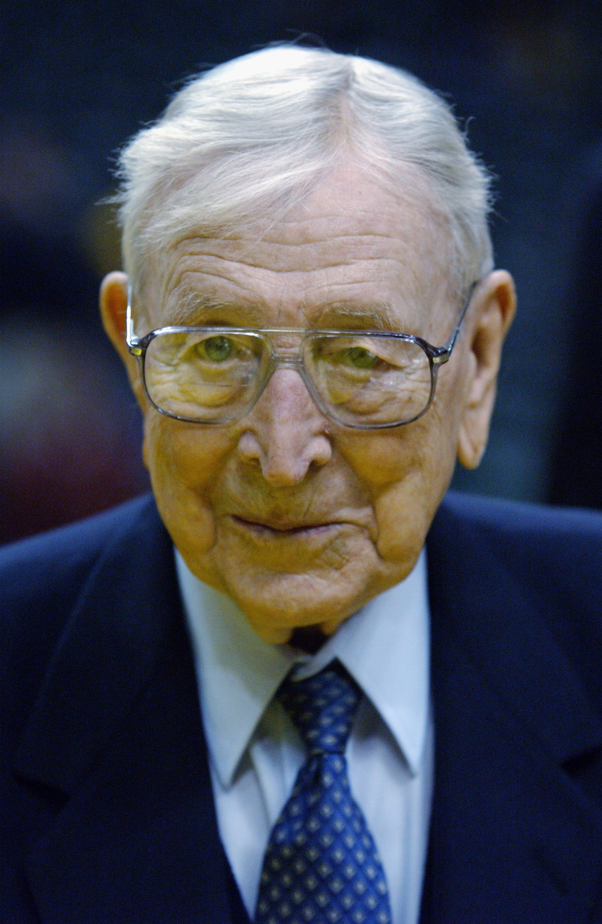John Wooden looks on