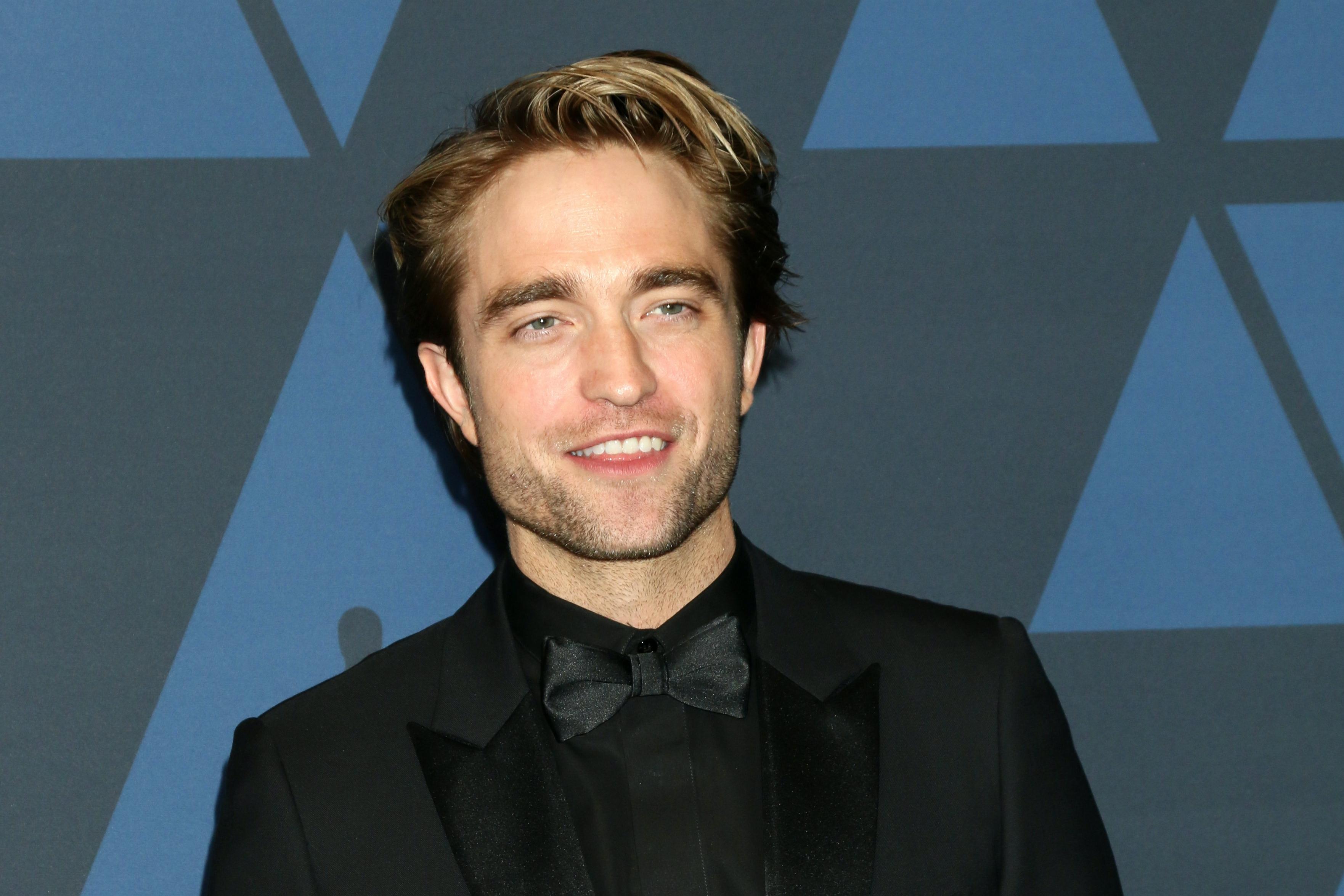 Robert Pattinson smiling.