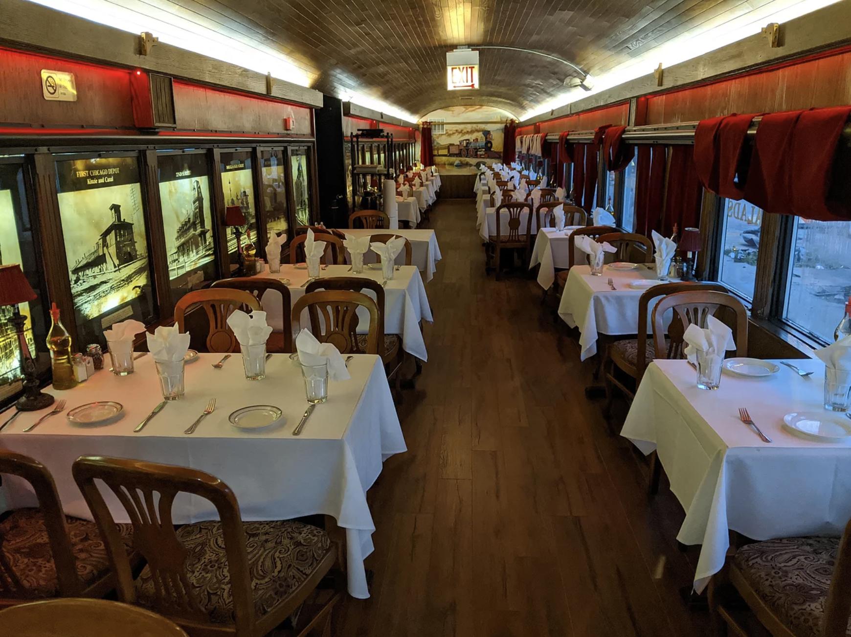 A dining room inside a narrow train car.