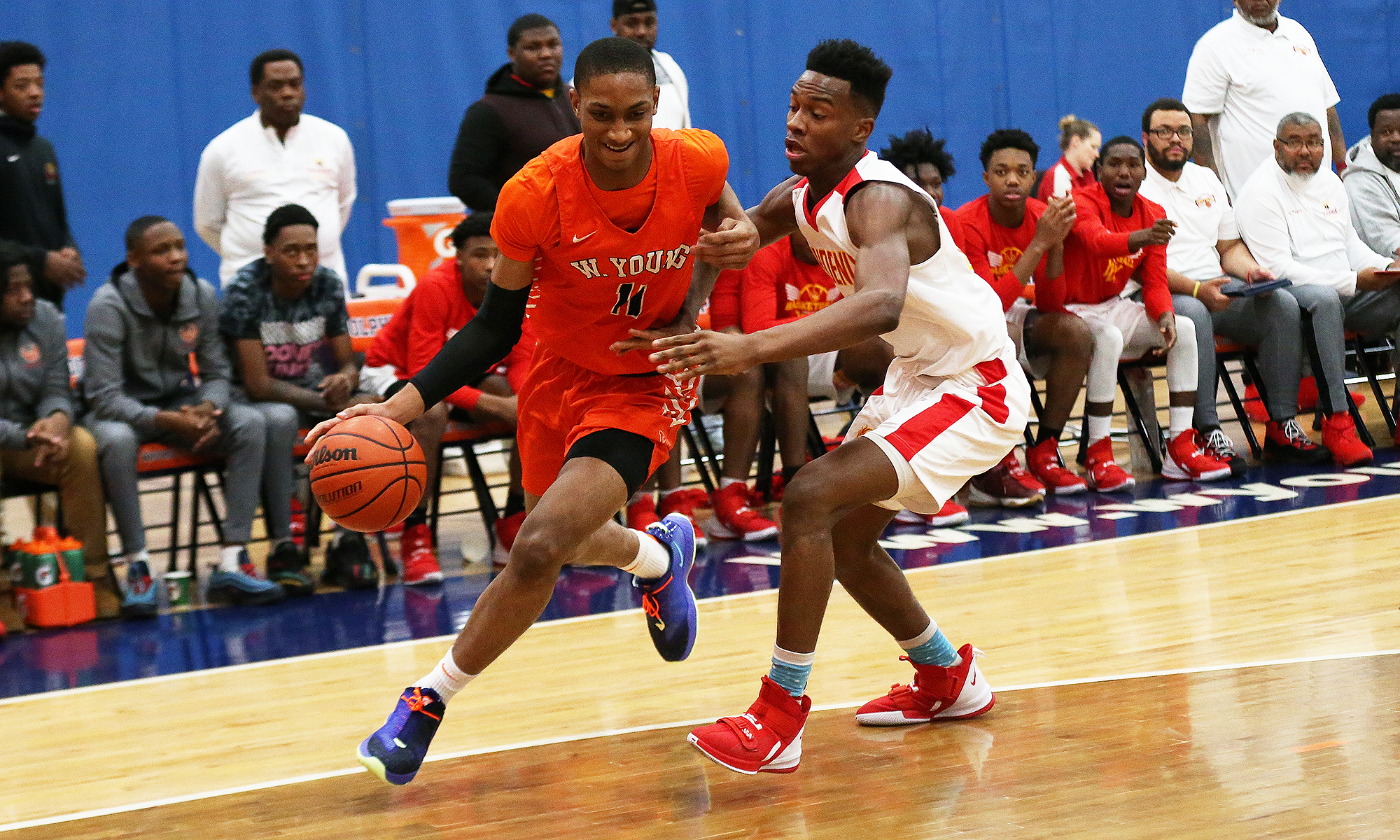 Young's Grant Newell (11) controls the ball as North Lawndale's Larry Johnson defends.