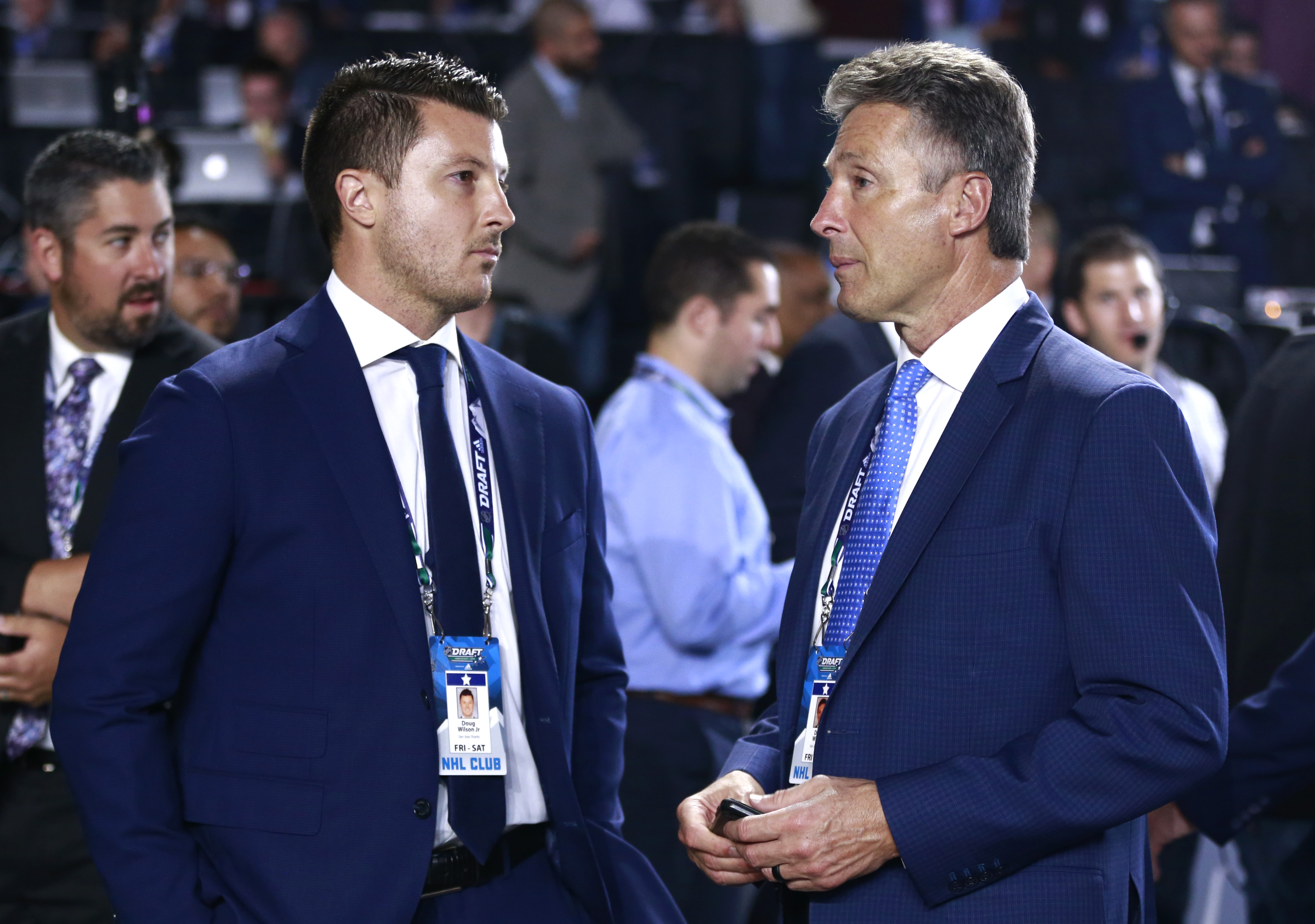 VANCOUVER, BRITISH COLUMBIA - JUNE 21: General Manager Doug Wilson of the San Jose Sharks (L) and Doug Wilson Jr. stand on the draft floor during the first round of the 2019 NHL Draft at Rogers Arena on June 21, 2019 in Vancouver, Canada.