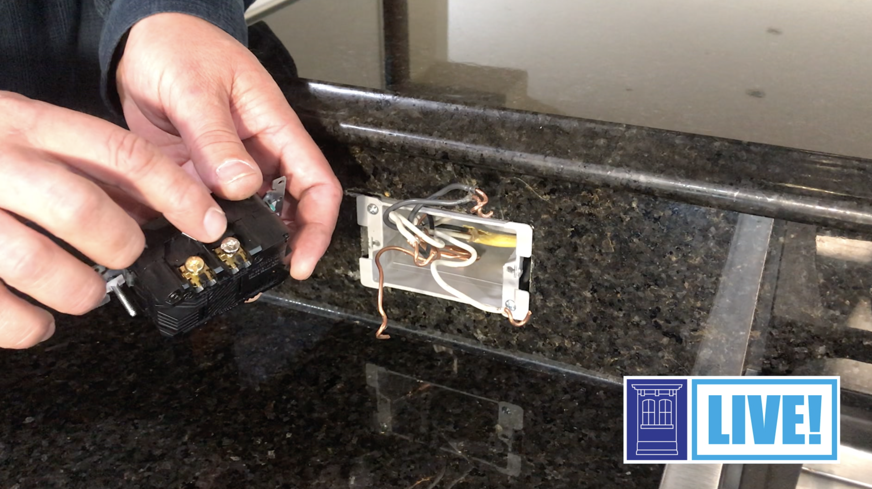 Master electrician Heath Eastman installs a USB outlet.