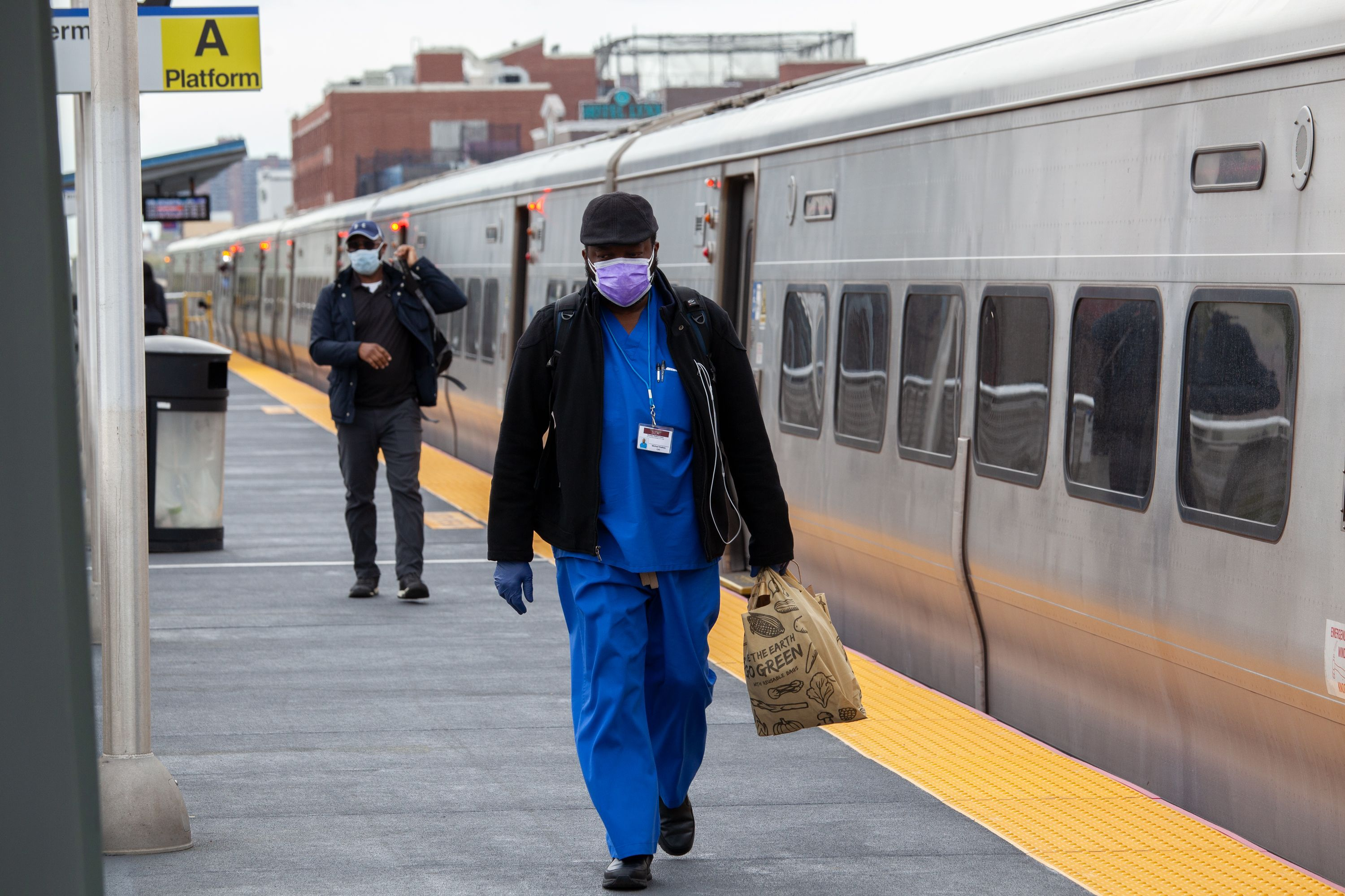 Workers exit an Atlantic Center-bound LIRR train at Nostrand Avenue.