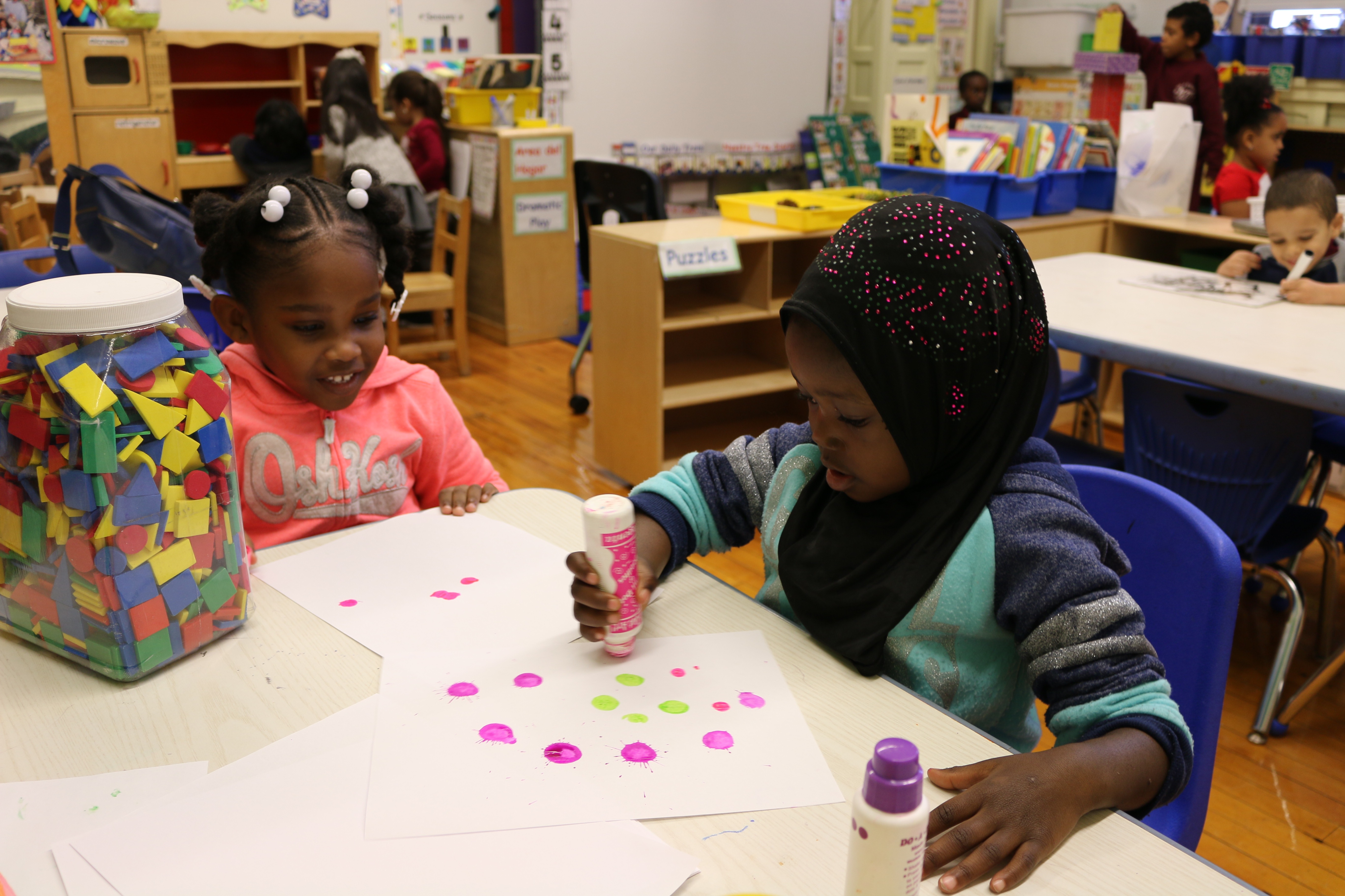 Pre-K students at P.S. 277 in the Bronx play with paint during center time. The education department announced a record number of families received an offer for their top-choice Pre-K for All program, but there were fewer applications overall.
