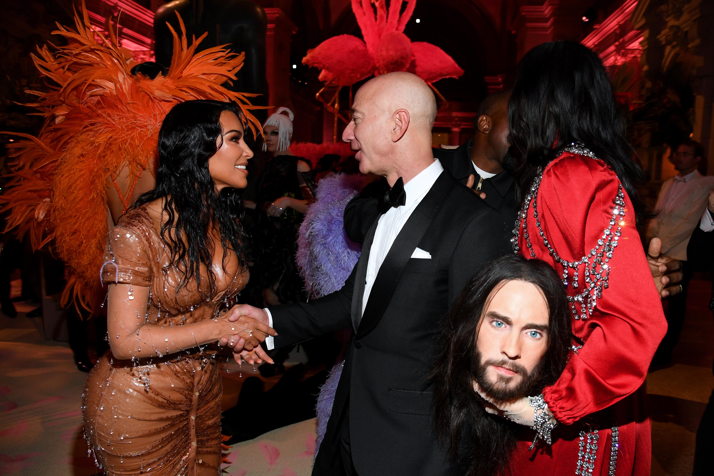 Jeff Bezos shaking hands with Kim Kardashian West.