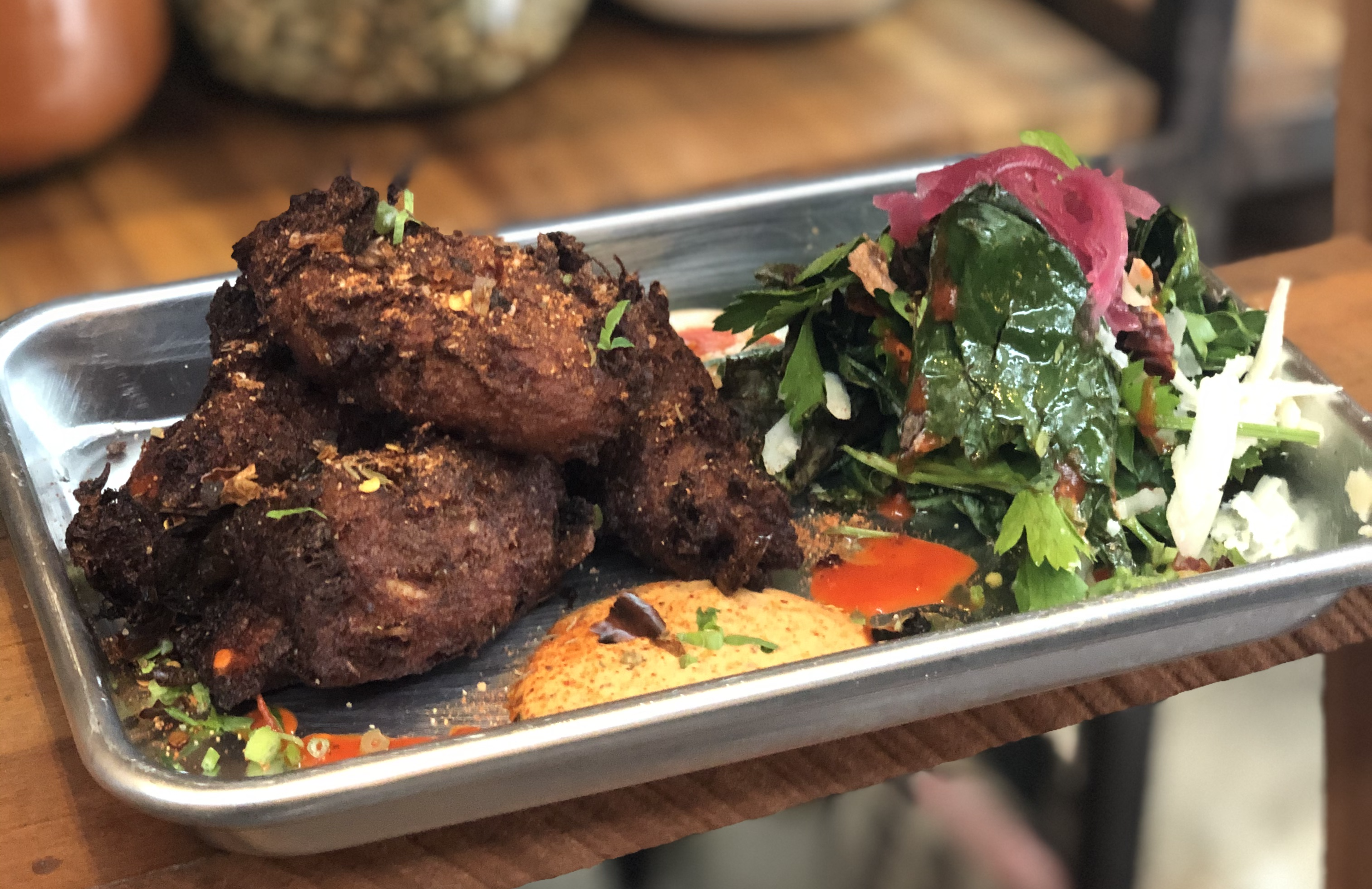Fried boudin balls served with a green salad