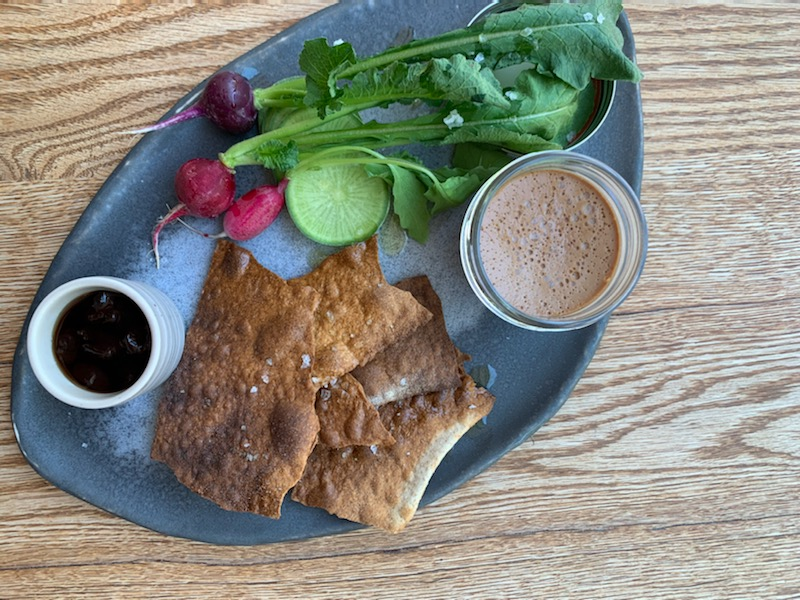 Duck liver mousse with crackers and sweet and sour cherries from Tail Up Goat