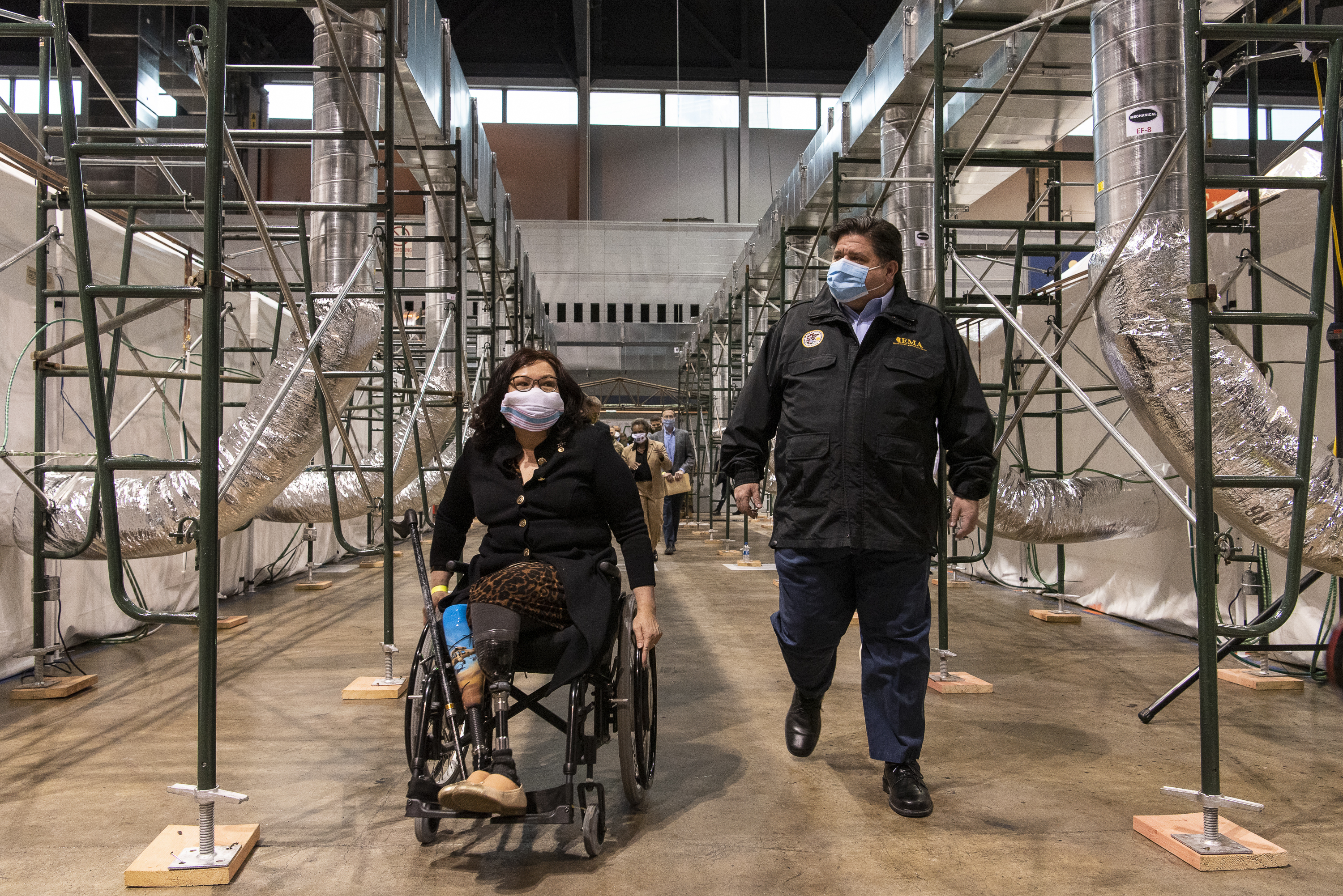 Sen. Tammy Duckworth, D-Illinois, and Gov. J.B. Pritzker tour a COVID-19 alternate care facility McCormick Place on April 17. Cook County Commissioner Brandon Johnson argues that residents of poorly run nursing homes who test positive for the virus could be cared for at the facility.