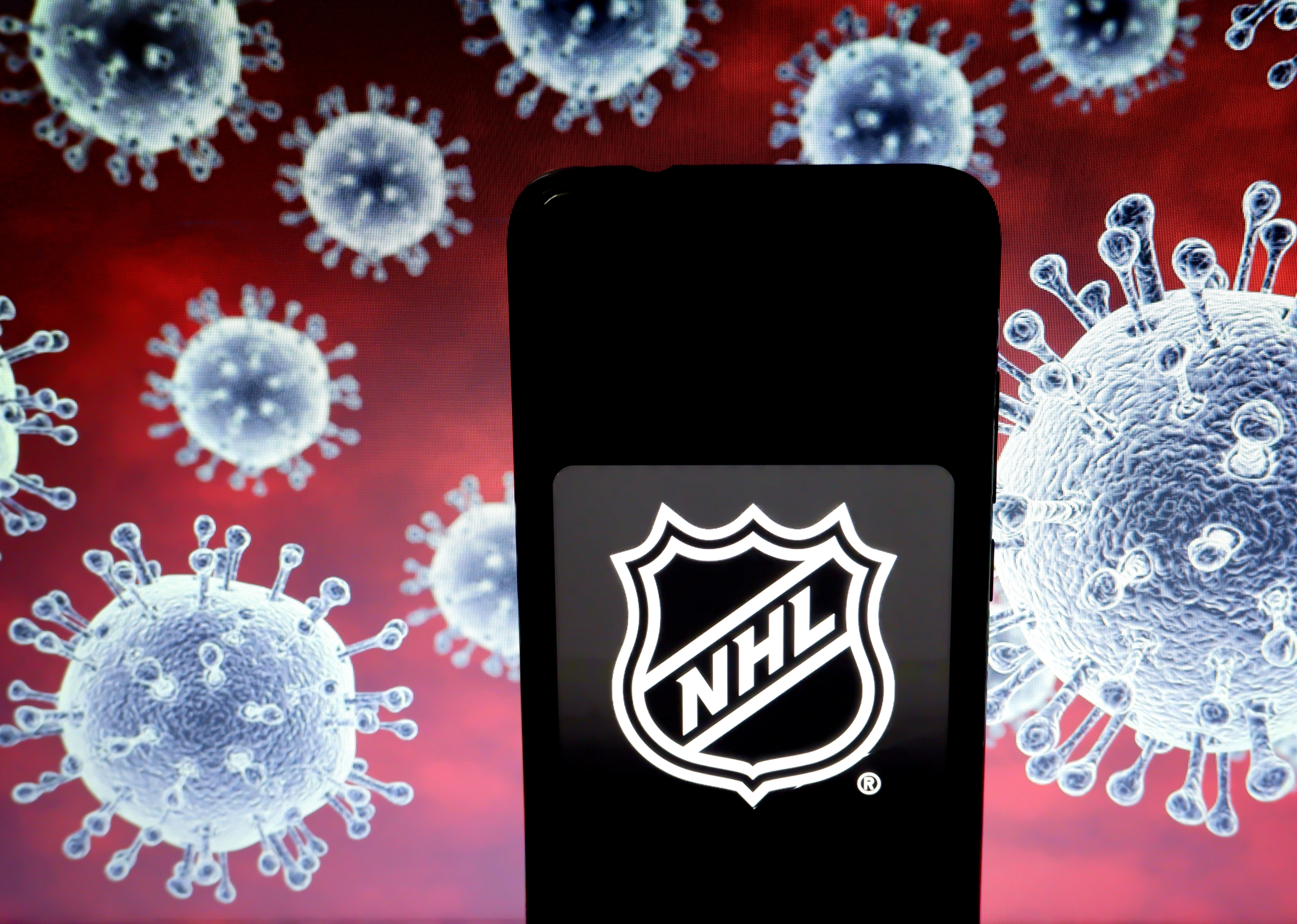 In this photo illustration a National Hockey League (NHL)...