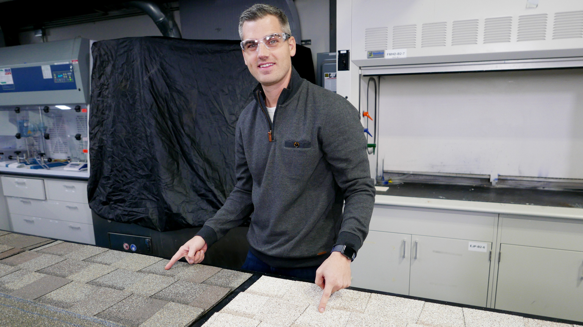 Home technology expert Ross Trethewey displays solar reflective roof shingles.