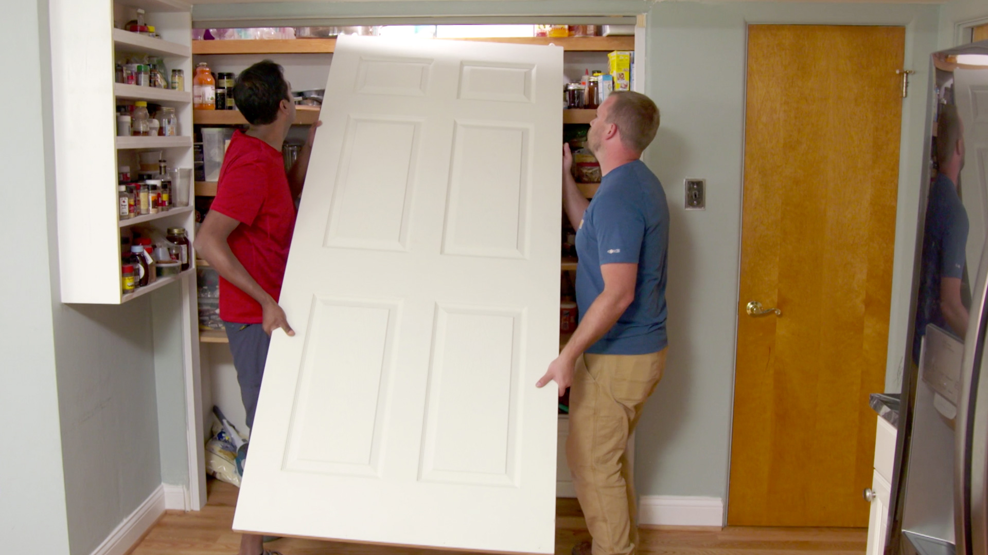 Installing bypass pantry doors.