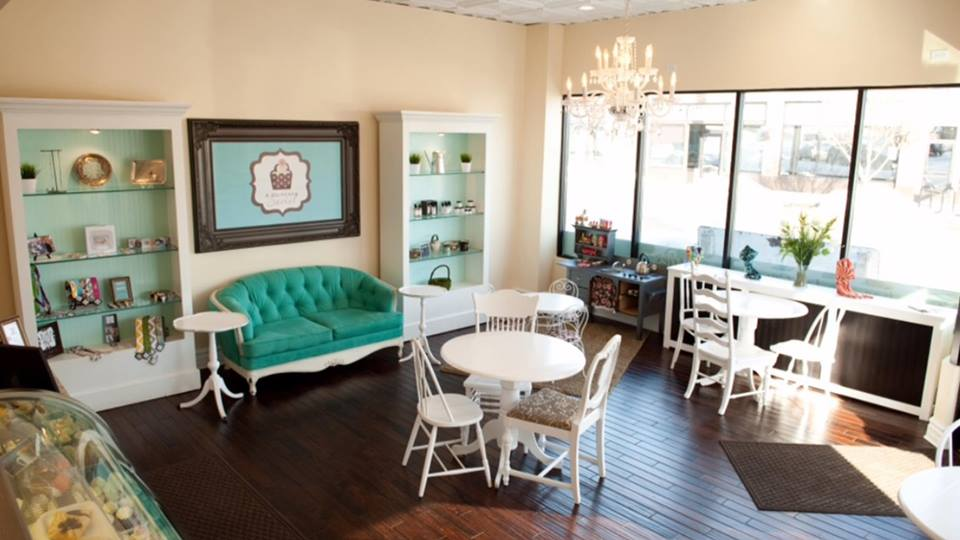 The diminuative dining area inside the shop, with vintage furniture and a children's play area