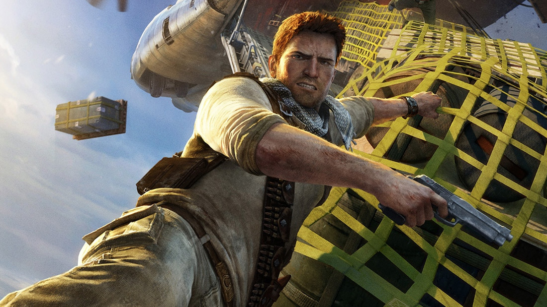 Nathan Drake hangs on to a plane cargo strap for his dear life in a promo shot from Uncharted