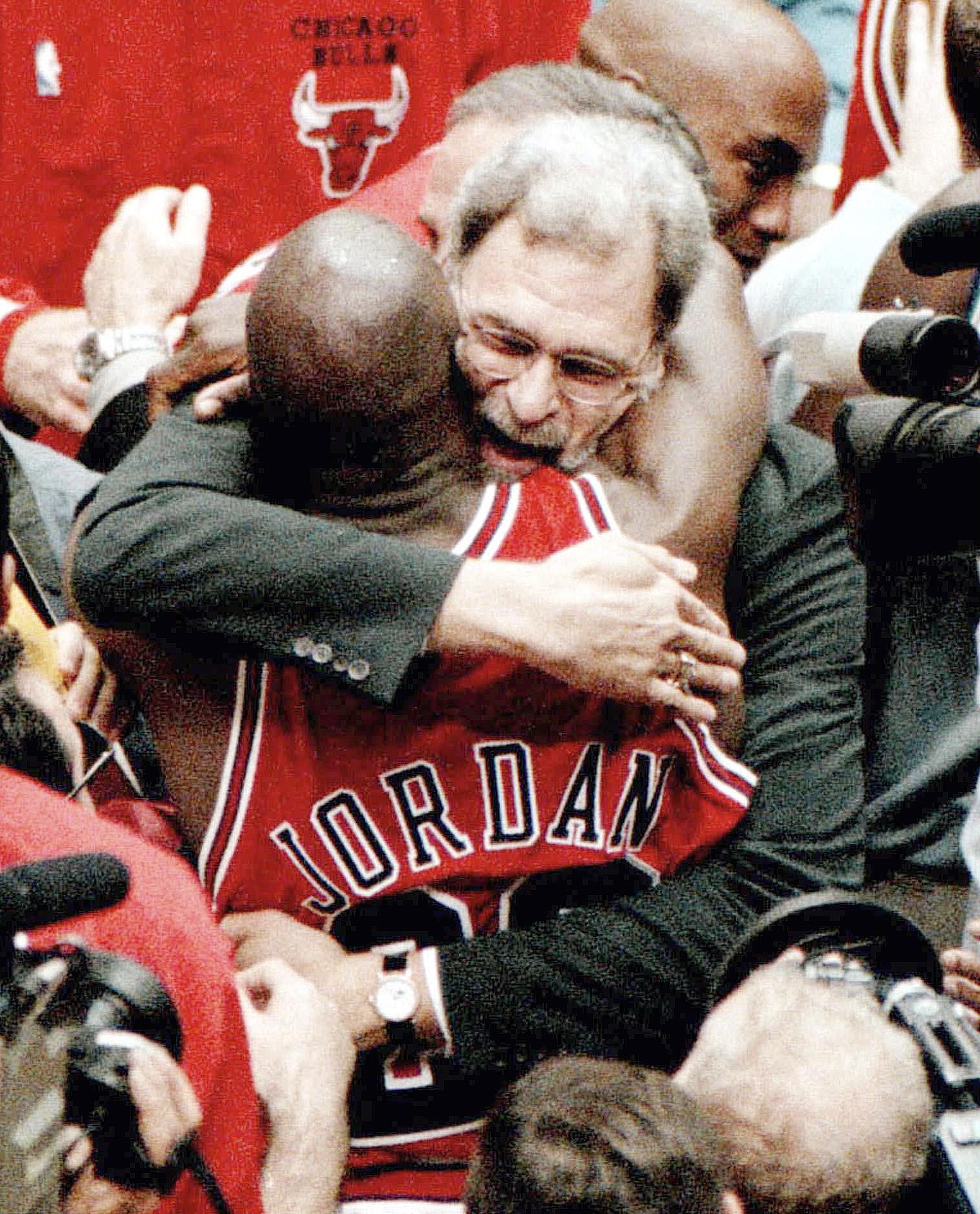 Phil Jackson and Michael Jordan embrace after the Bulls won their sixth NBA championship.