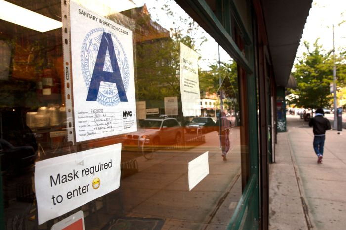 A restaurant storefront with an A letter grade