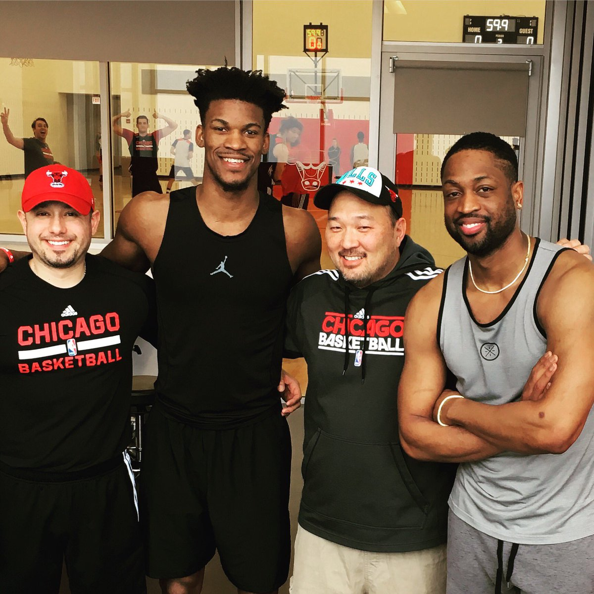 The Bulls have dismissed head trainer Jeff Tanaka (second from right).