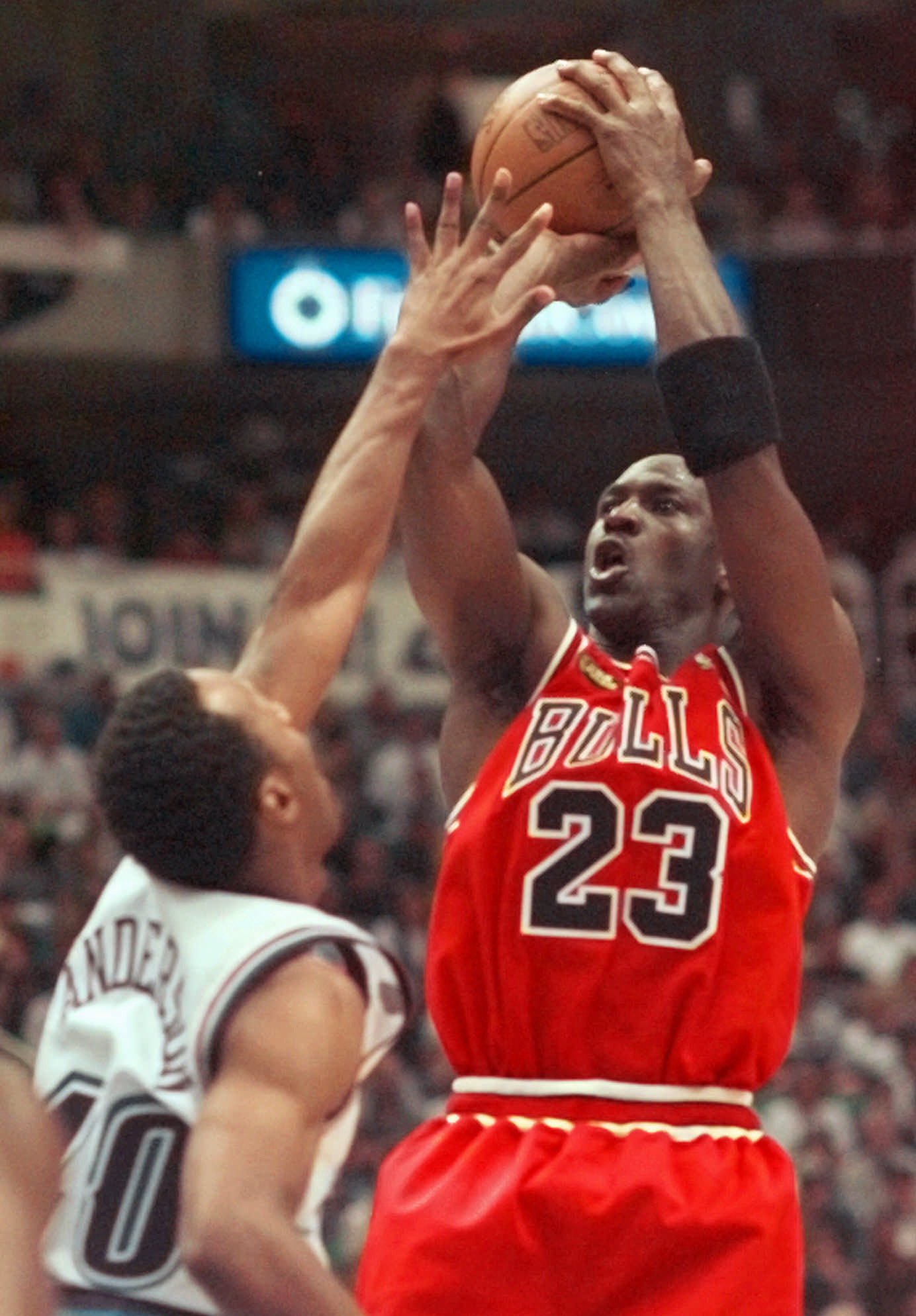 Michael Jordan shoots over the Utah Jazz's Shandon Anderson in Game 6 of the 1998 NBA Finals.