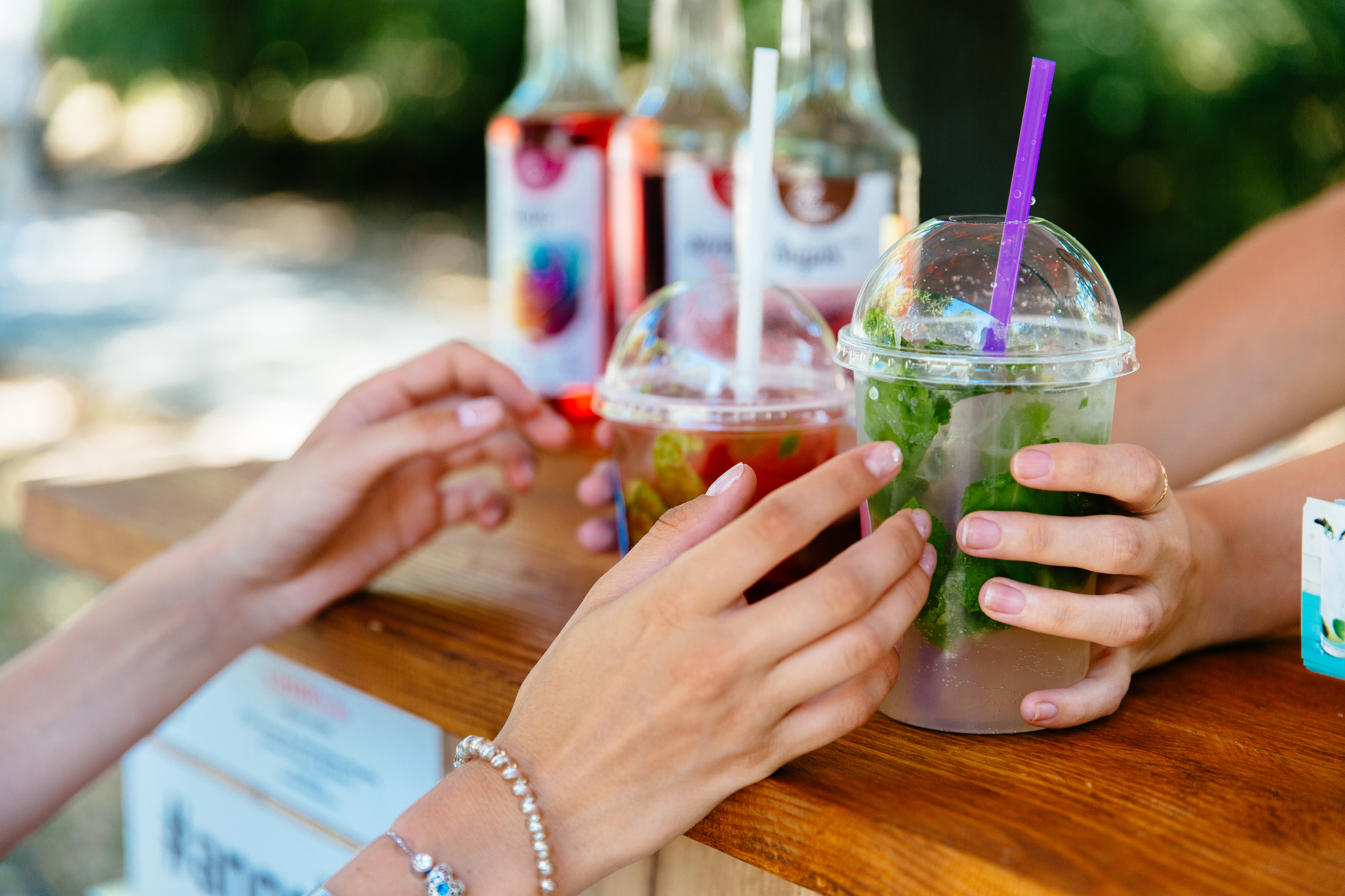 A woman purchasing outdoor cocktails