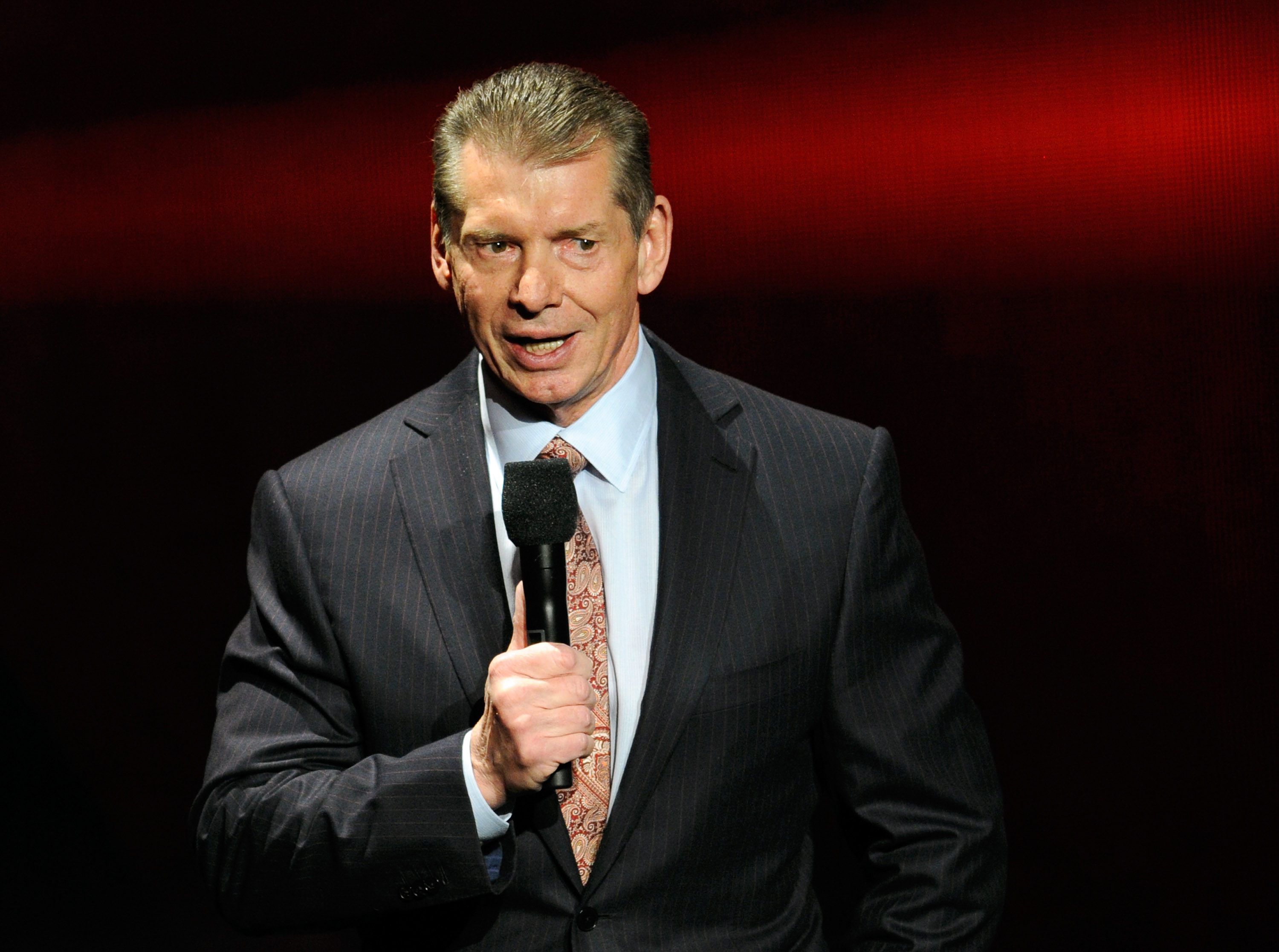 WWE Chairman and CEO Vince McMahon speaks at a news conference announcing the WWE Network at the 2014 International CES at the Encore Theater at Wynn Las Vegas on January 8, 2014 in Las Vegas, Nevada.