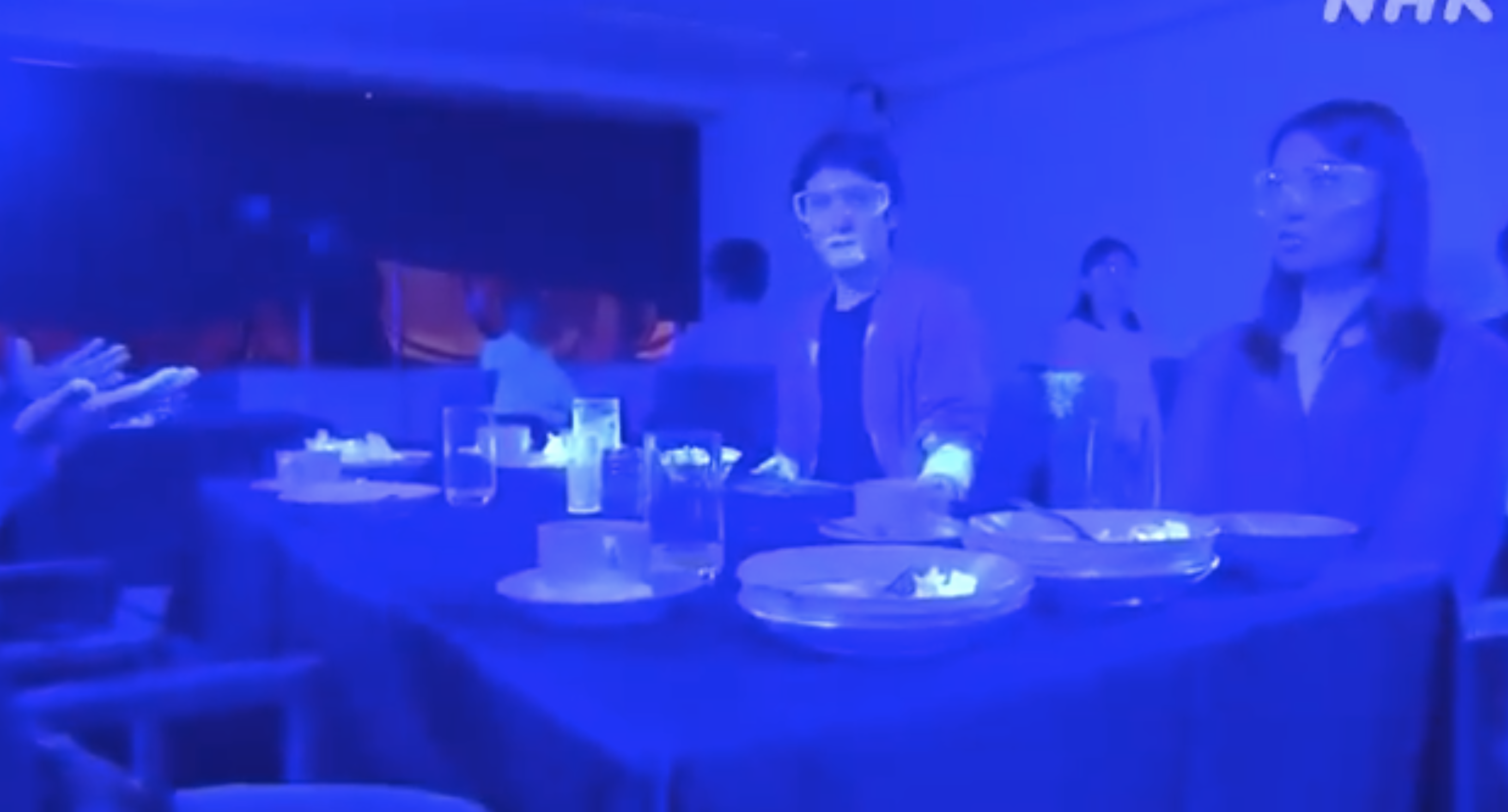Japanese public broadcaster NHK conducted a new black light experiment to show a virus like the coronavirus can spread in a buffet-like area.