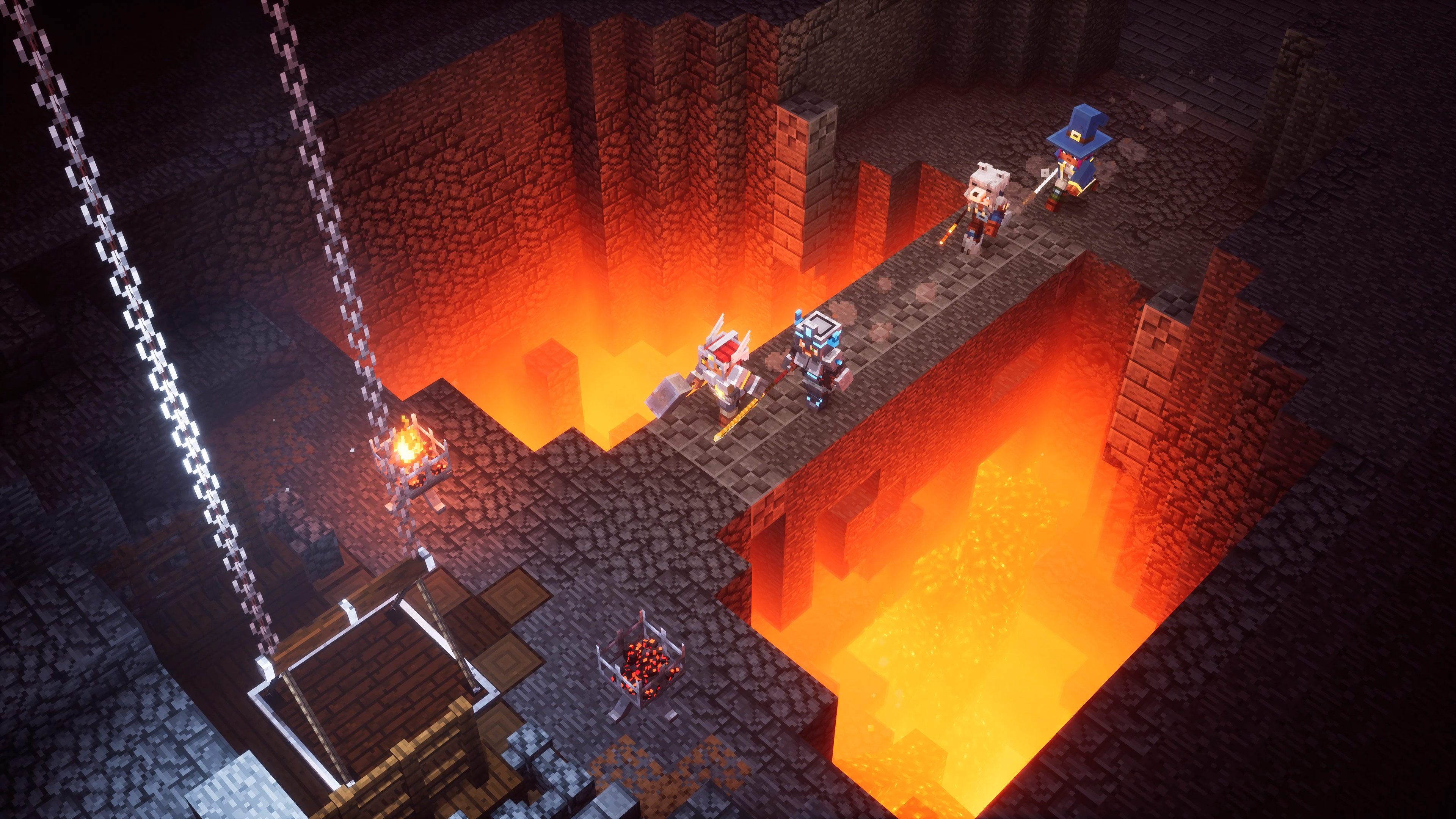 Dungeon crawlers crossing a bridge over lava in Minecraft Dungeons