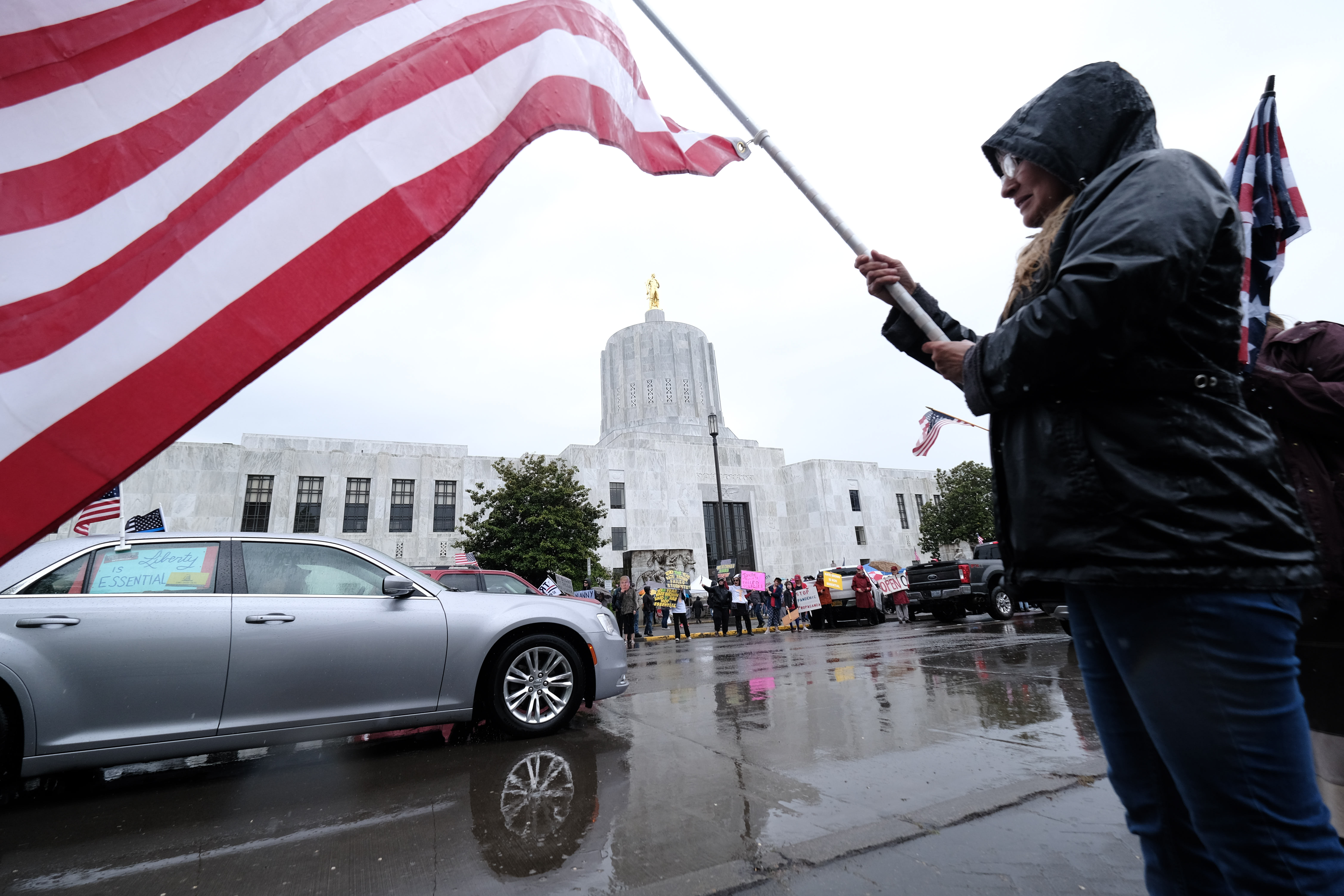 Protestors Rally At Oregon State Capitol Against Stay-At-Home Order