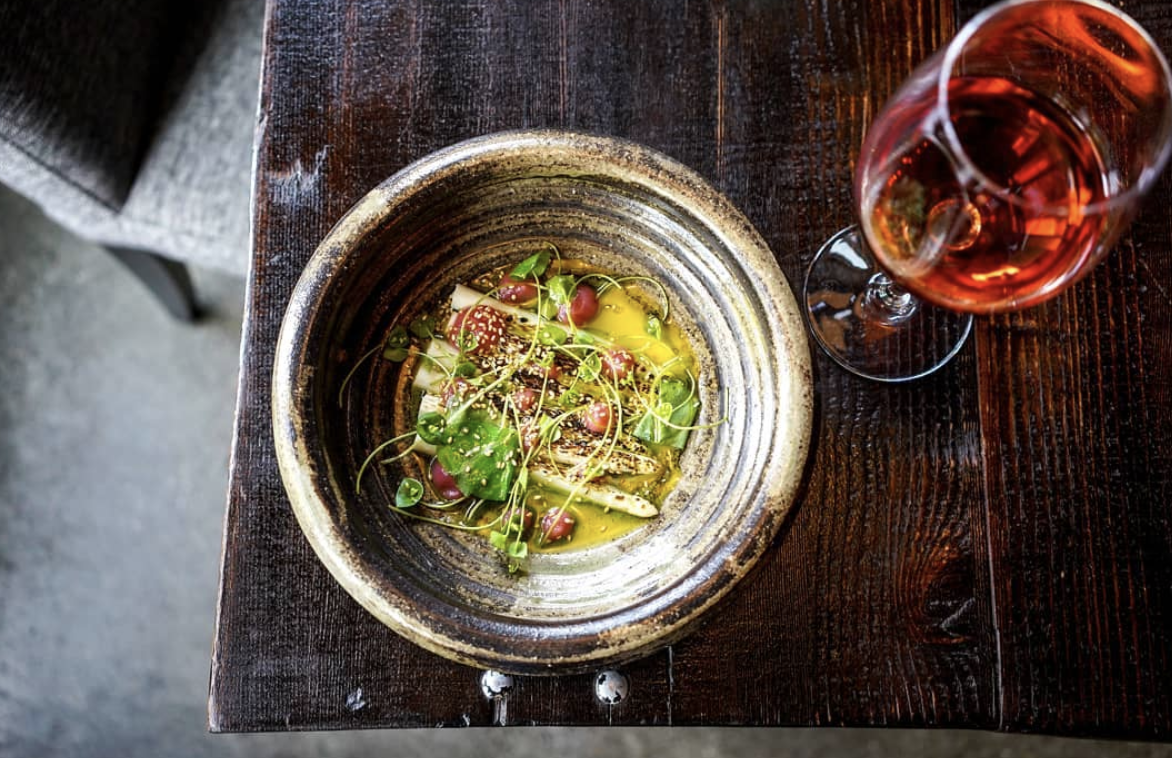 Adana brings artful presentation to its seasonal dishes, such as white asparagus with egg yolk and rhubarb gelee.