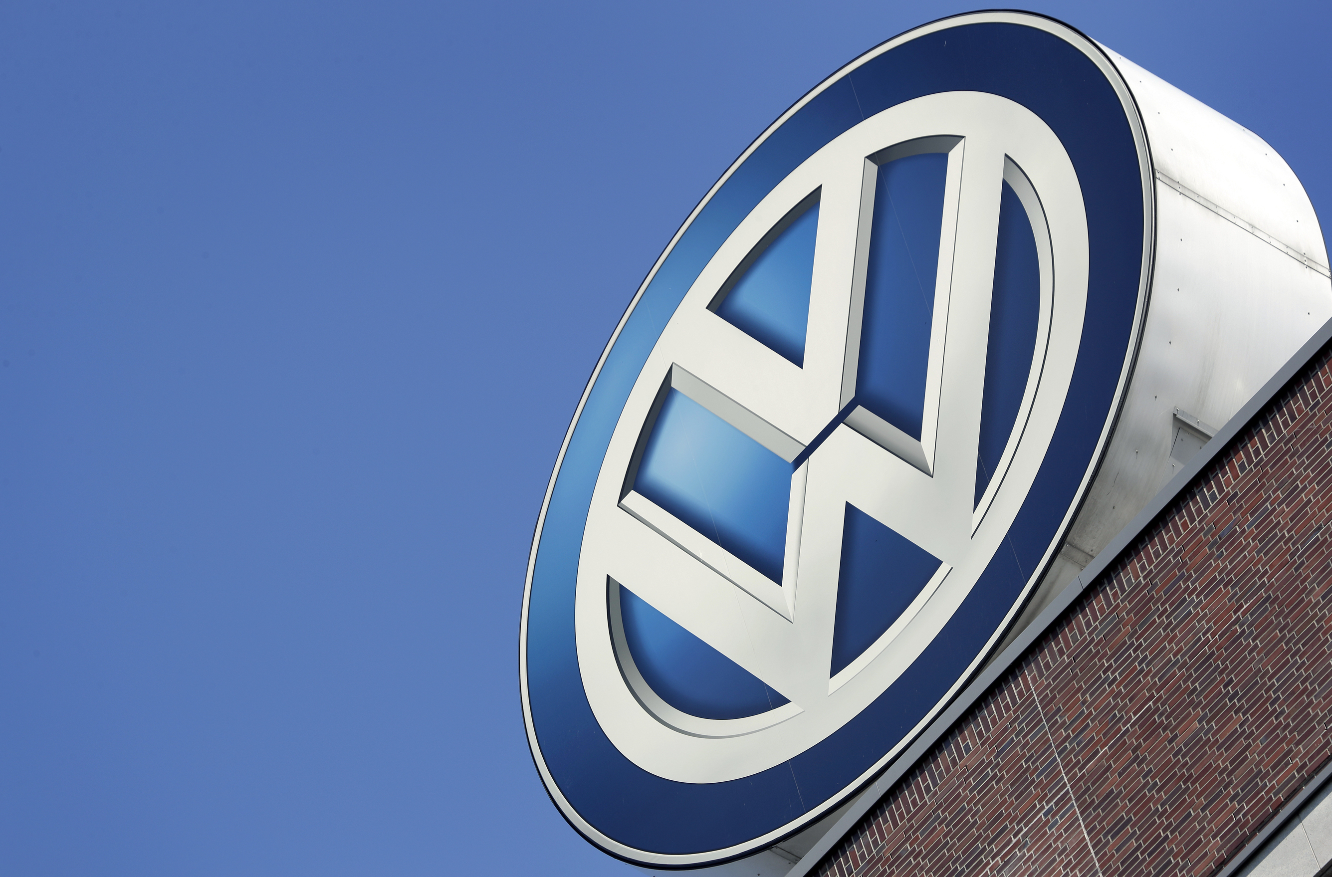 In this Wednesday, Aug. 1, 2018 file photo, the logo of Volkswagen is seen on top of a company building in Wolfsburg, Germany.