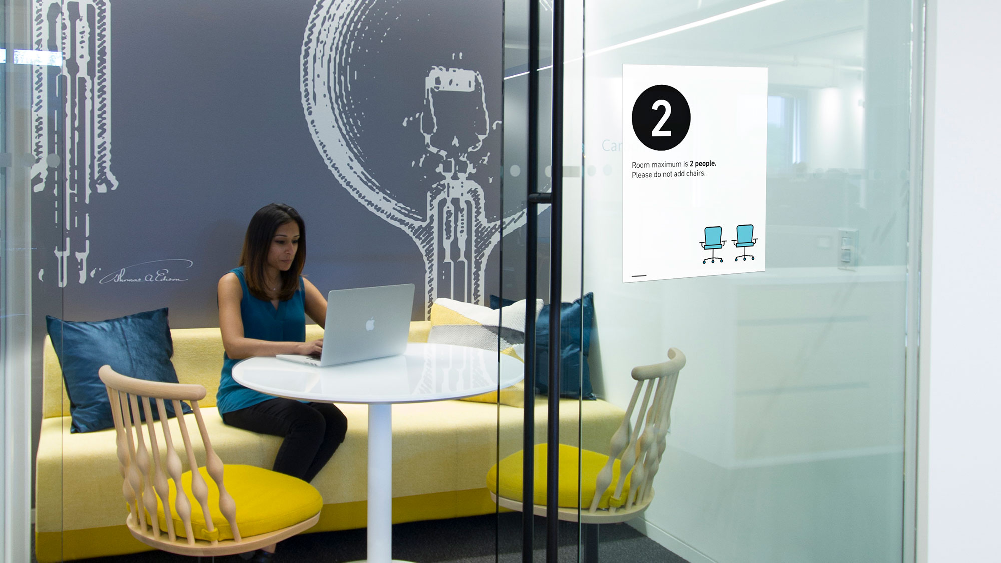 An office conference room displays a sign limiting occupancy to two people. It's an example of suggestions the design firm Gensler is providing to clients.