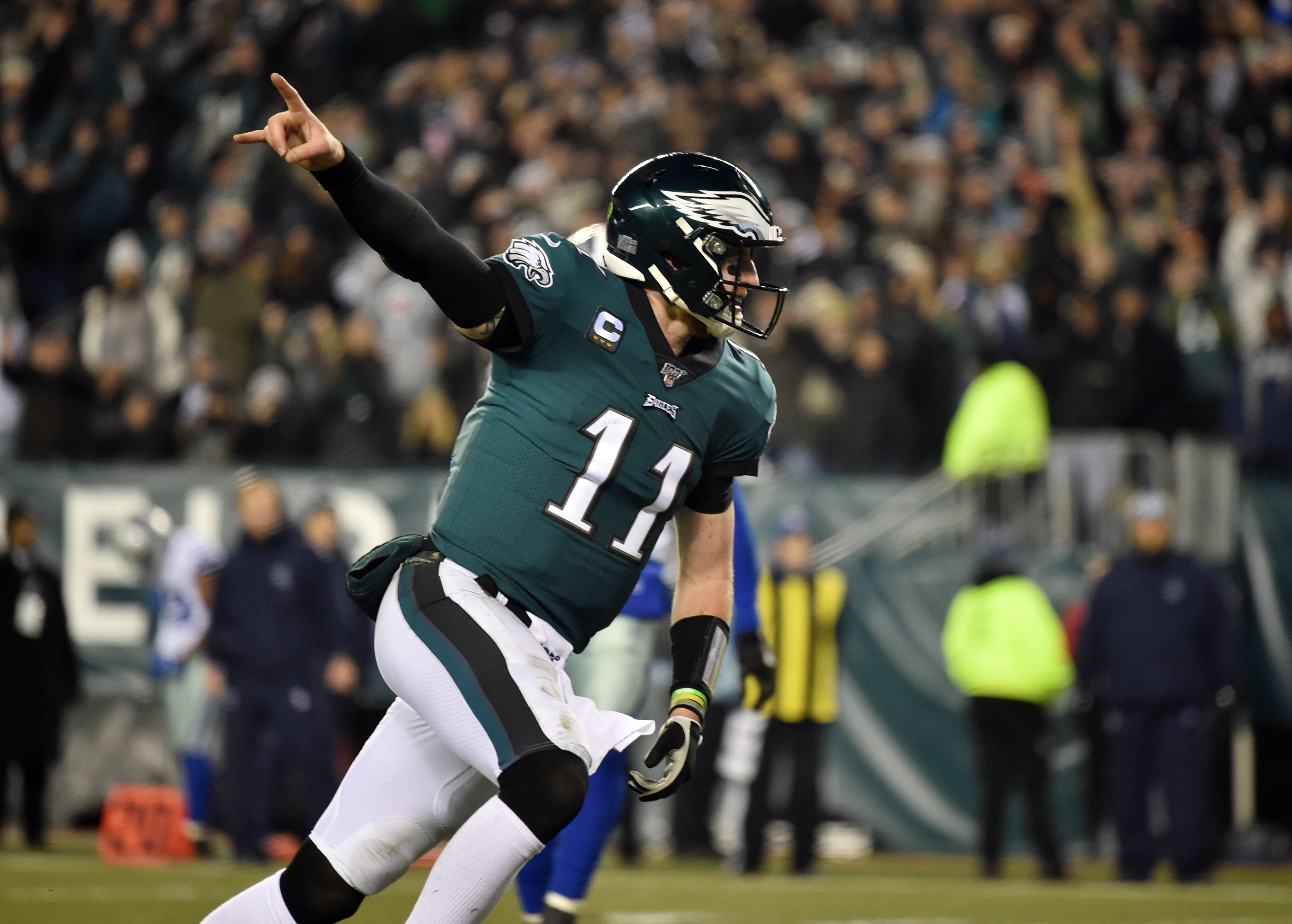 Philadelphia Eagles quarterback Carson Wentz reacts after a touchdown run by running back Miles Sanders (not pictured) during the third quarter at Lincoln Financial Field.