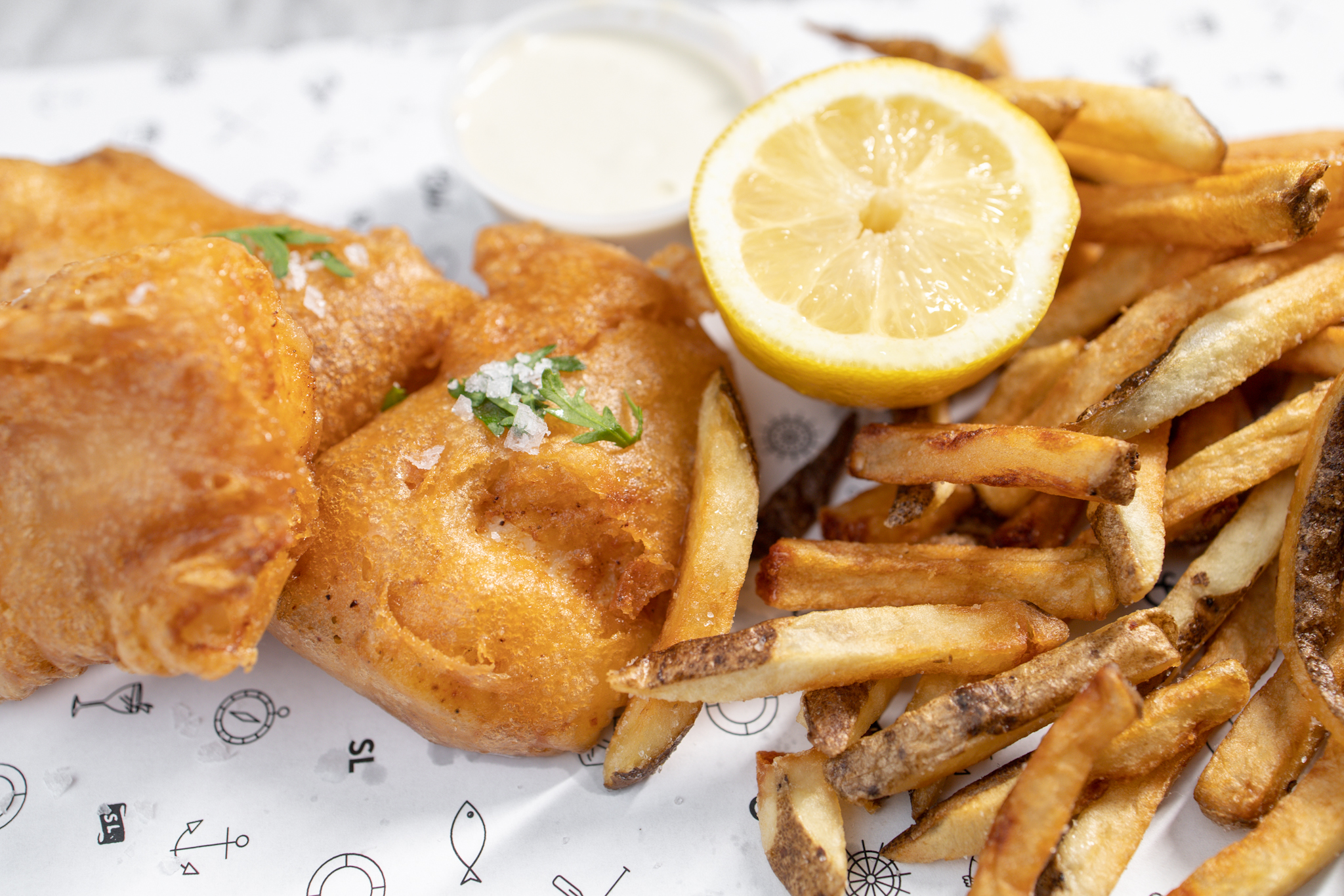 A plate of Oui Chippy's fish and chips