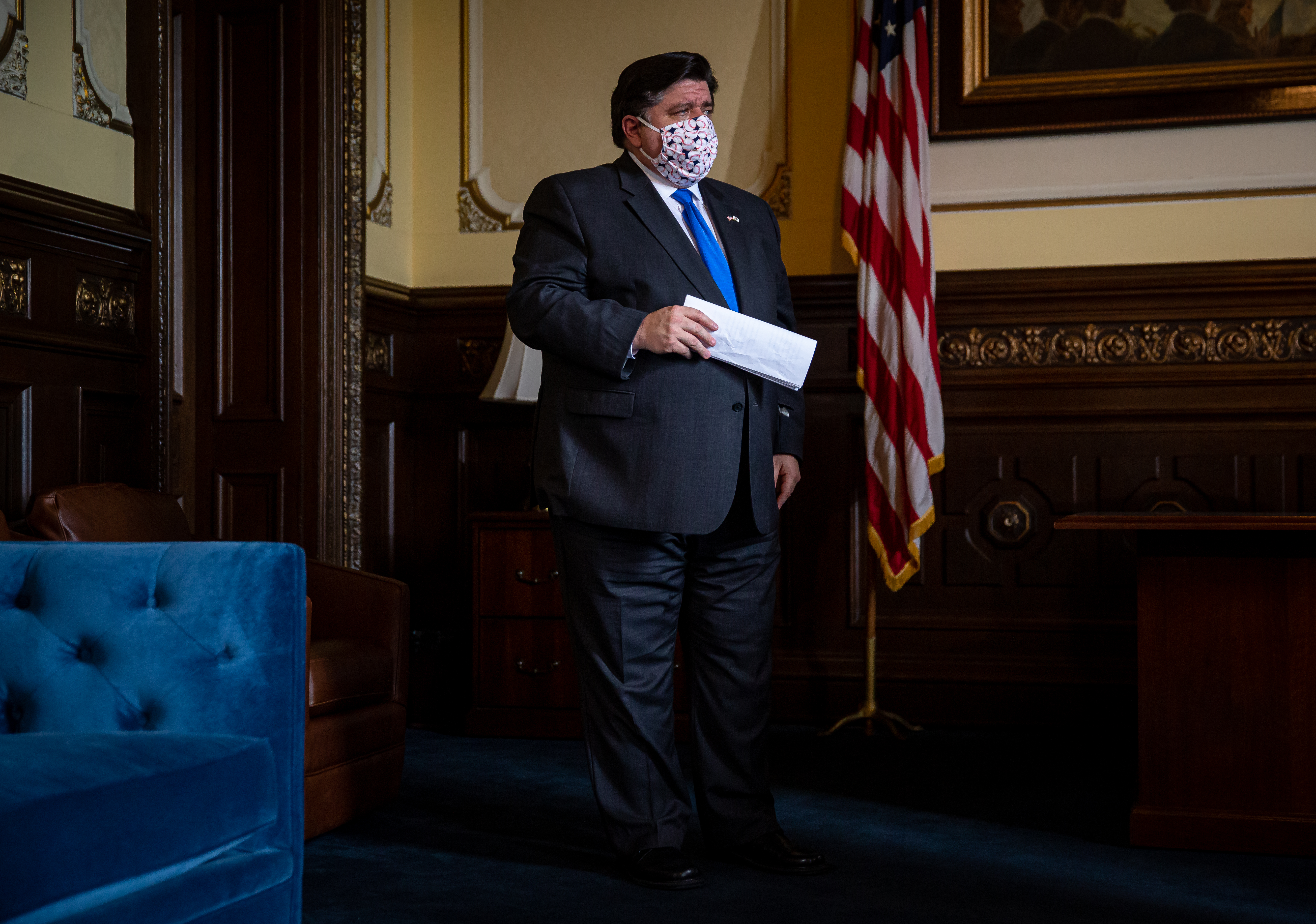 Gov. J.B. Pritzker waits to speak during his daily briefing on the COVID-19 pandemic from his office at the Illinois State Capitol in Springfield on Friday.