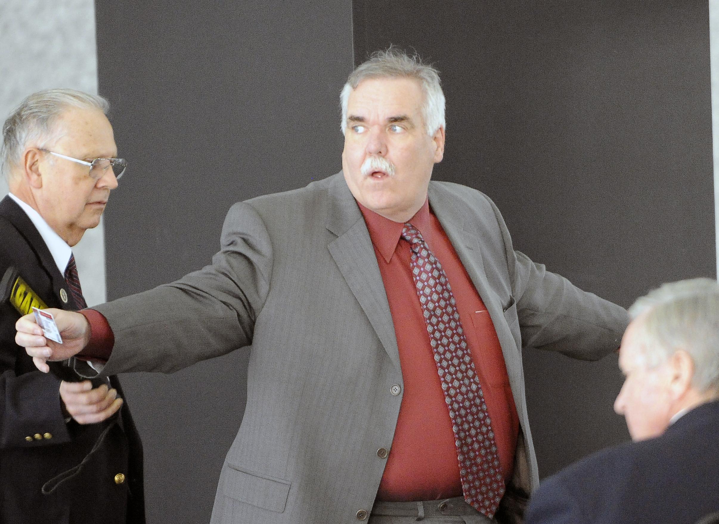 Glenn Lewellen arrives for his trial at Dirksen Federal Building in 2011.