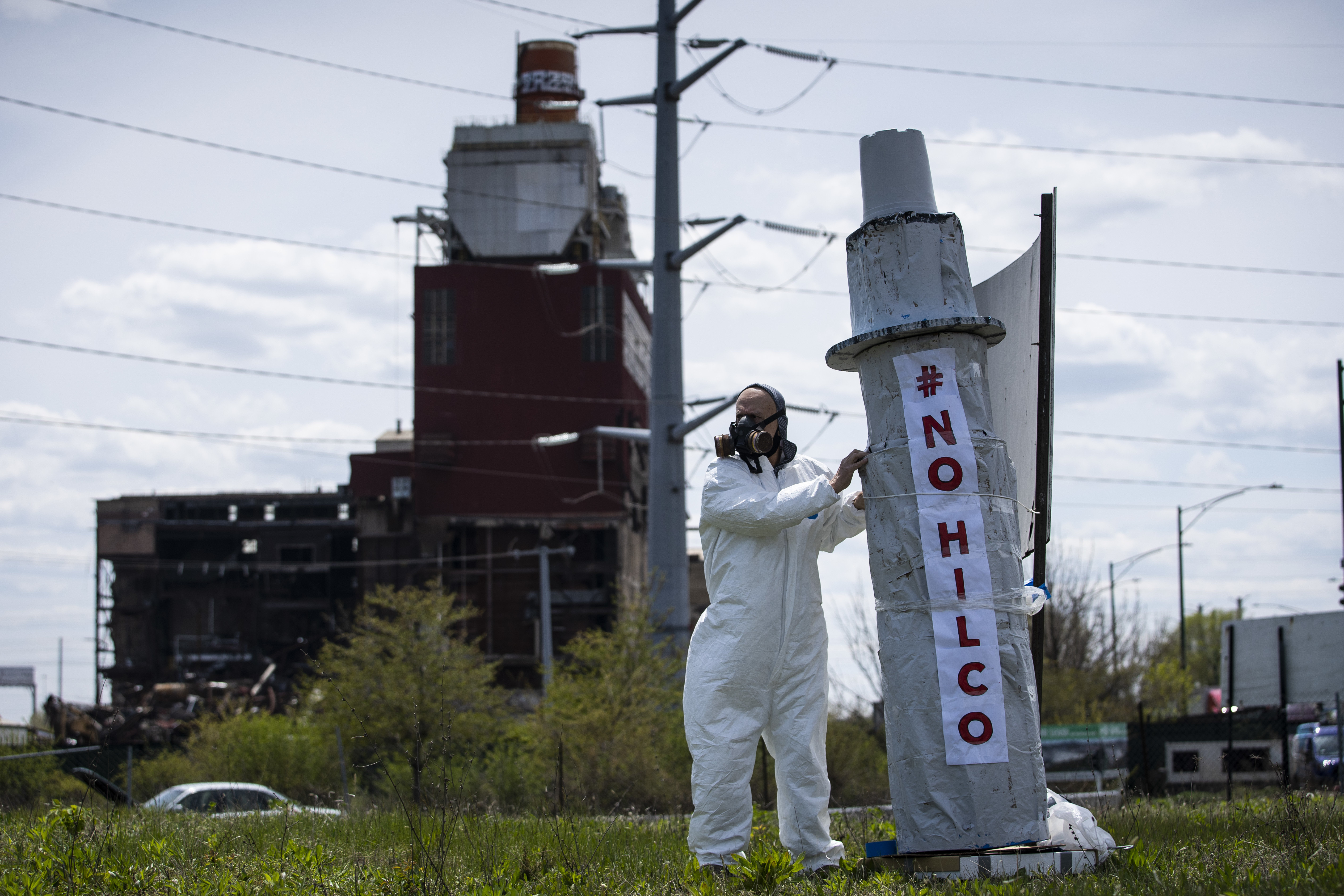 A man protests outside the site of the closed Crawford power plant near West 33rd Street and South Pulaski Road earlier this month.