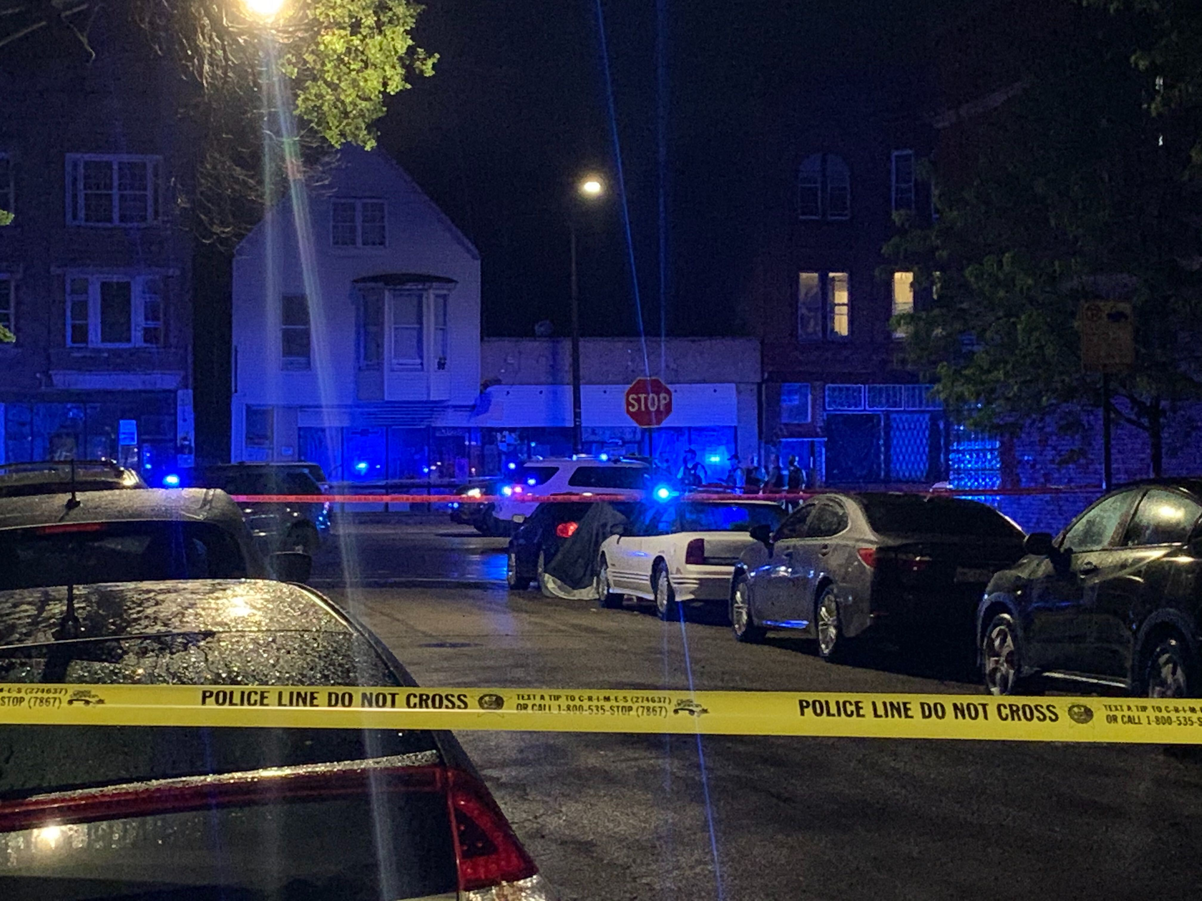 Police investigate the scene where a man was shot to death May 23, 2020, in the 3400 block of West North Avenue in Humboldt Park.
