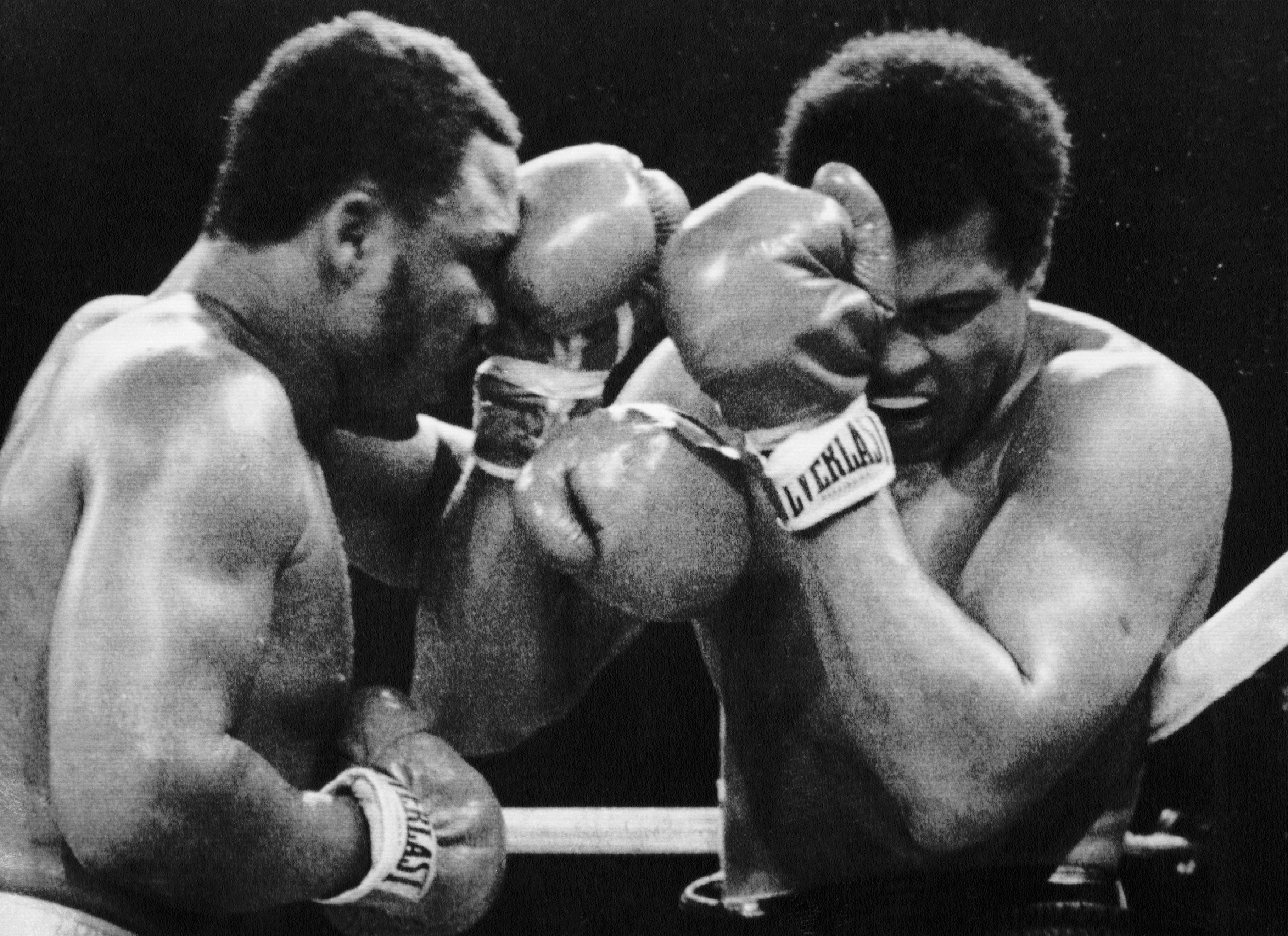Muhammad Ali Covers As Joe Frazier Punch