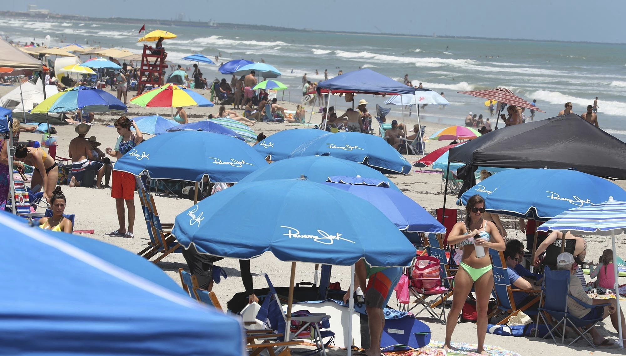 Cocoa Beach, Fla., is packed with Memorial Day beachgoers on Saturday, May 23, 202 The beaches are open for business again during the coronavirus epidemic.