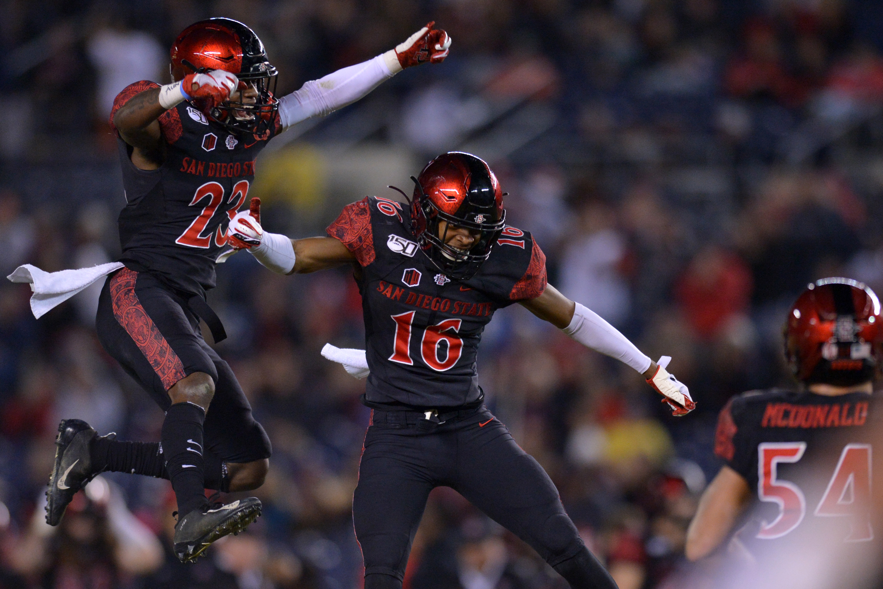 San Diego State cornerback Luq Barcoo celebrates with cornerback Darren Hall during the fourth quarter after an interception against Fresno State.