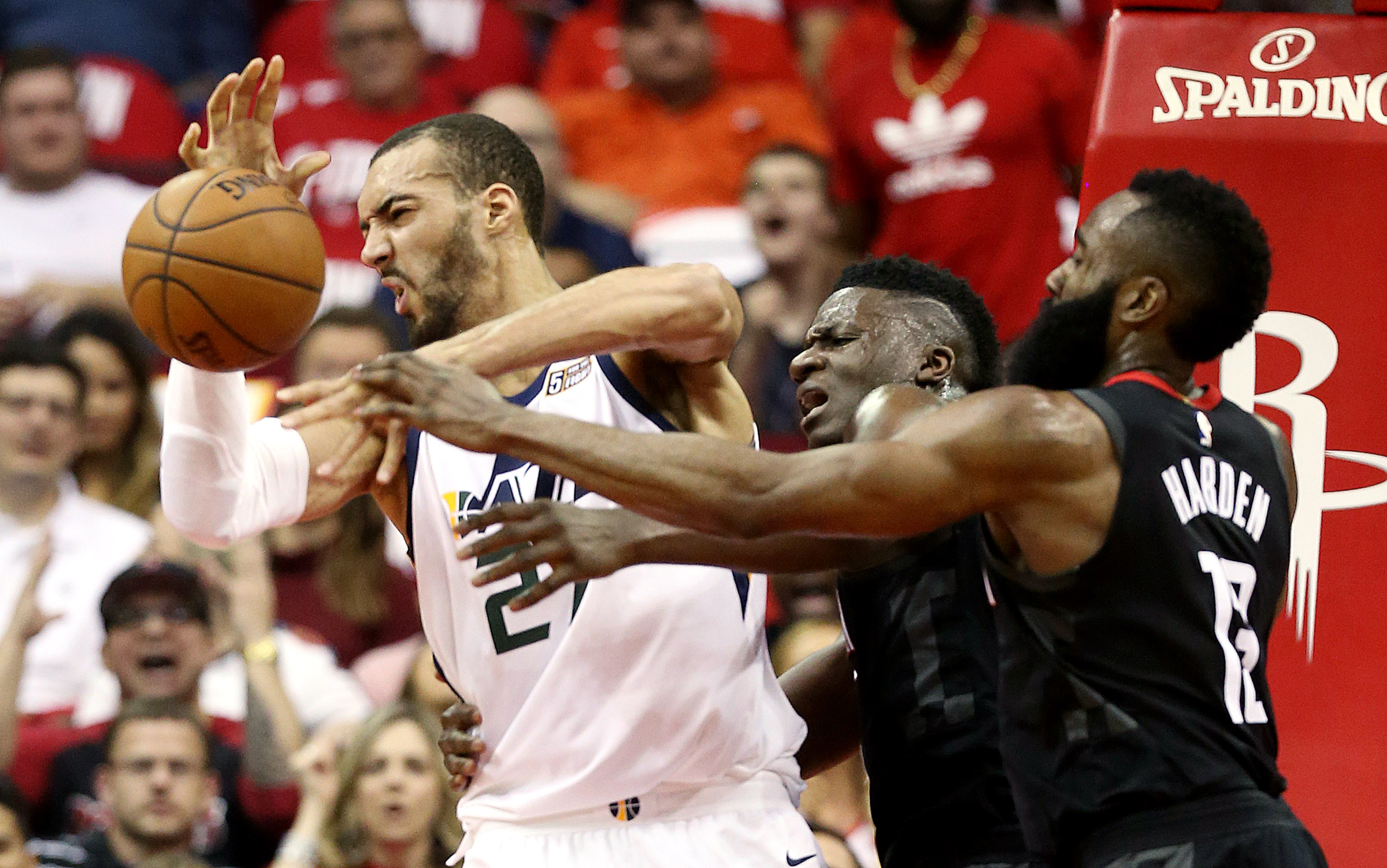 Utah Jazz center Rudy Gobert (27) is fouled by Houston Rockets guard James Harden (13) as the Utah Jazz and the Houston Rockets play Game 2 of the Western Conference semifinals at the Toyota Center in Houston on Wednesday, May 2, 2018.
