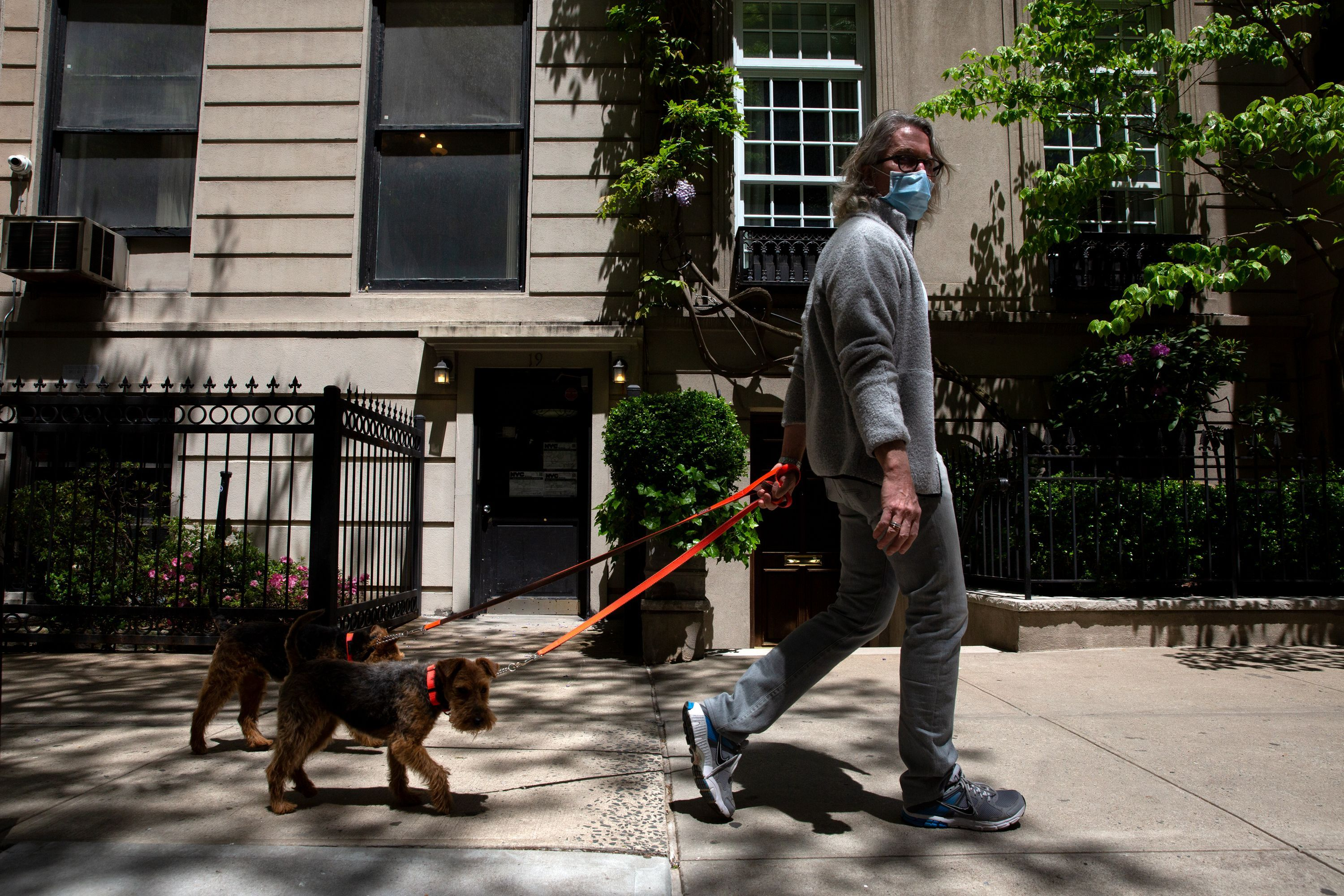 People enjoy a warm spring day on the Upper East Side during the coronavirus.