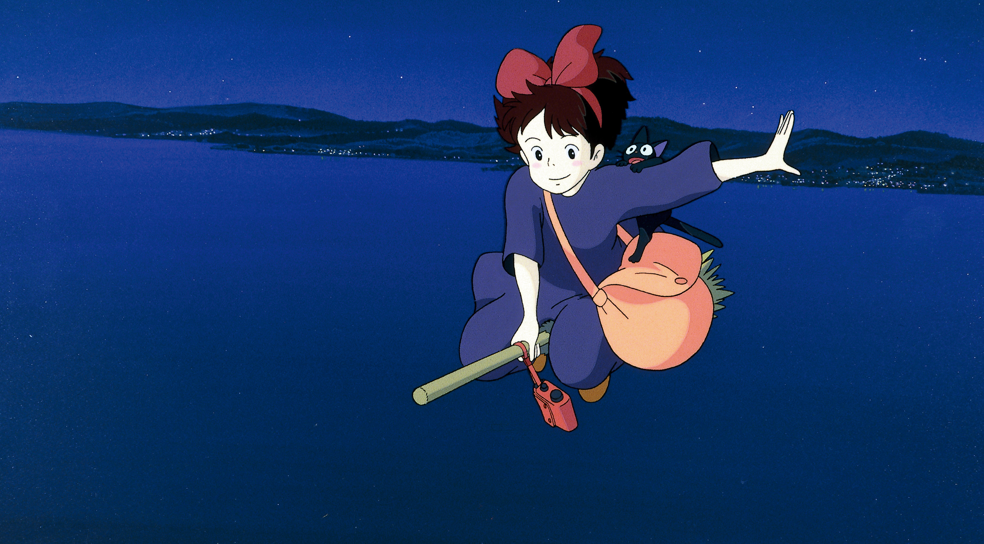 kiki flying on her broom at night