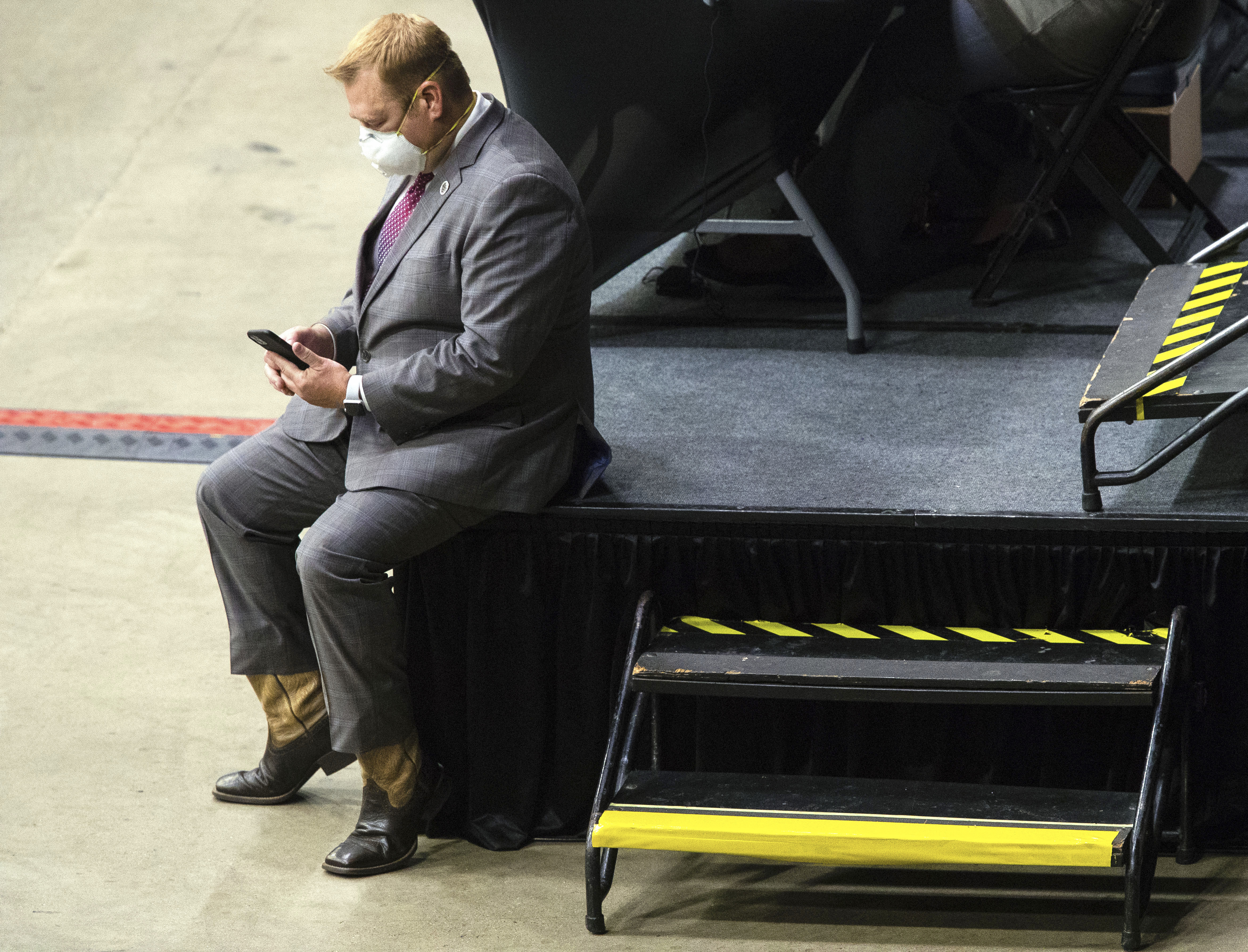 State Rep. Allen Skillicorn, R-East Dundee, looks at his phone during debate last week at the Bank of Springfield Center in Springfield.