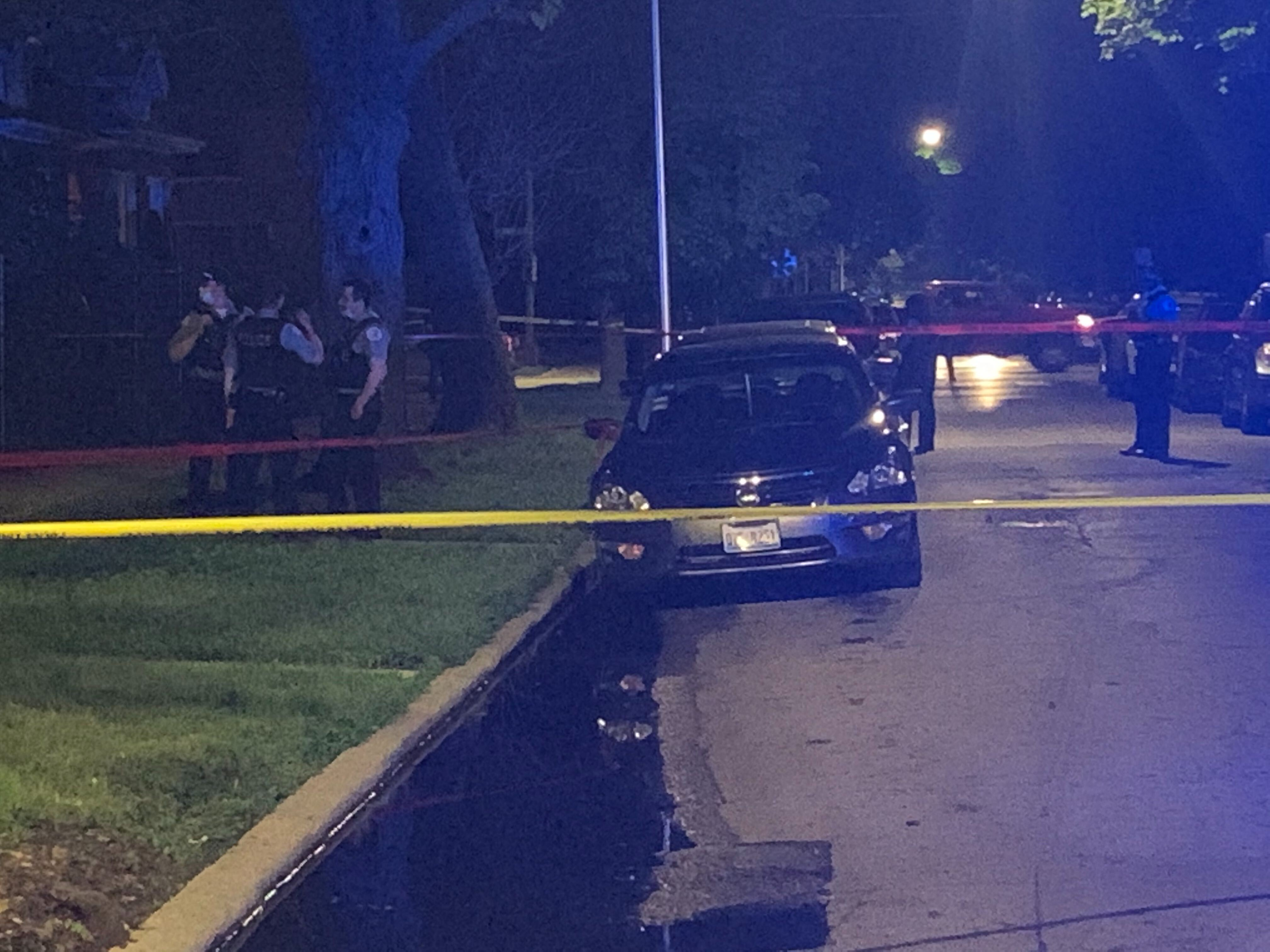 Police investigate the scene where a man was shot and killed May 26, 2020, in South Shore.