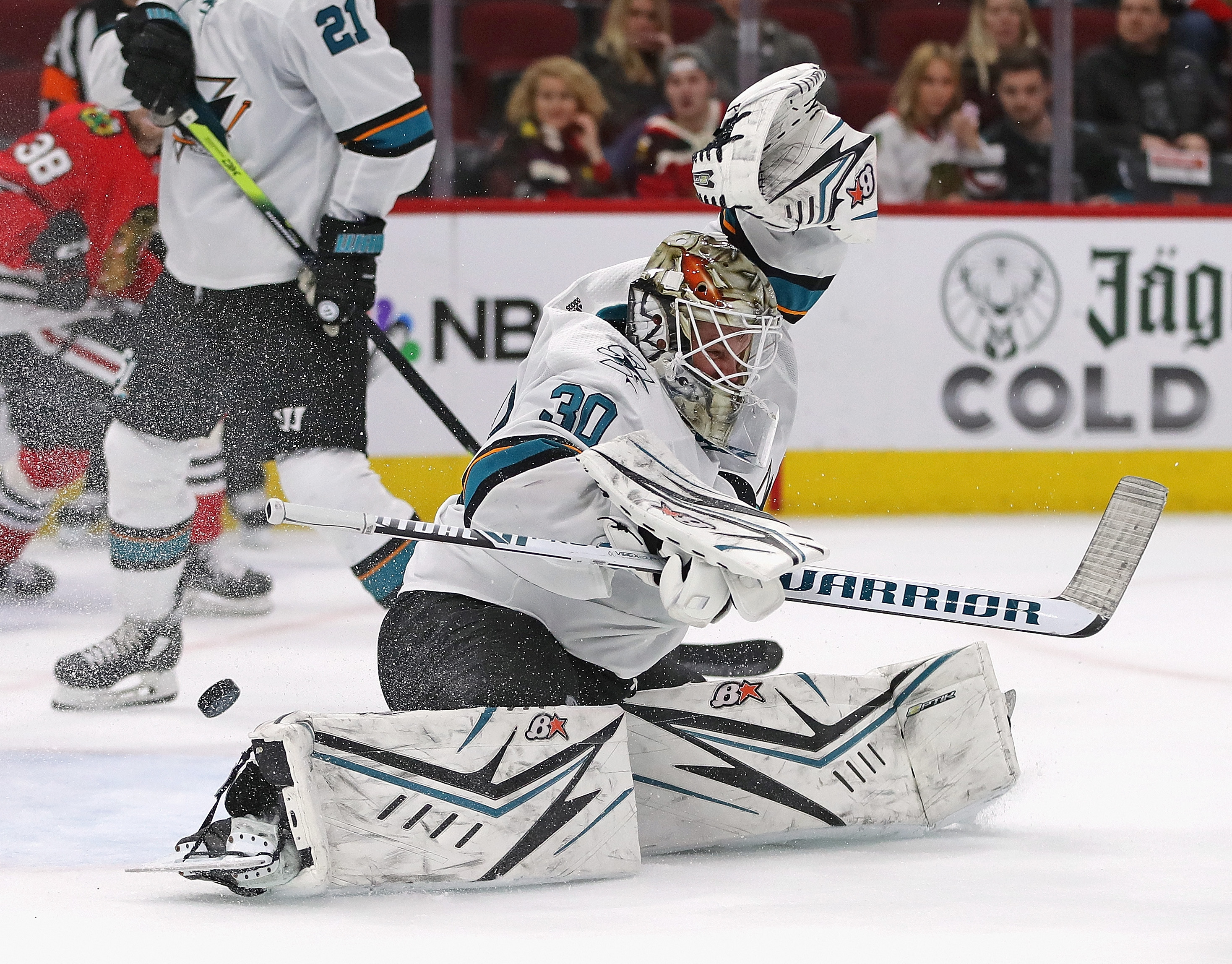 CHICAGO, ILLINOIS - MARCH 11: The puck slips past Aaron Dell #30 of the San Jose Sharks on a goal by the Chicago Blackhawks at the United Center on March 11, 2020 in Chicago, Illinois. The Blackhawks defeated the Sharks 6-2.