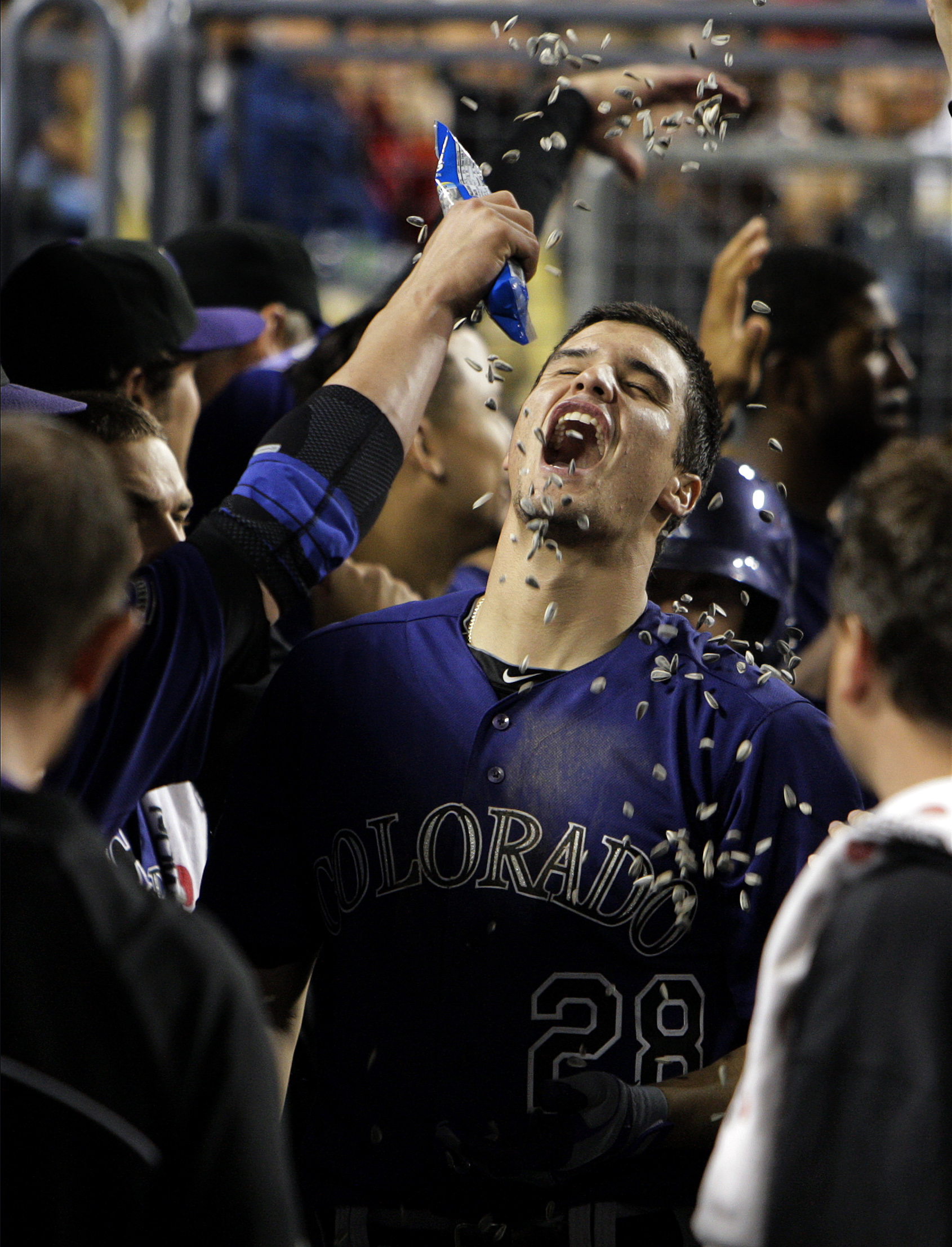 Colorado Rockies third baseman Nolan Arenado (28) is doused with sunflower seeds in the dugout afte