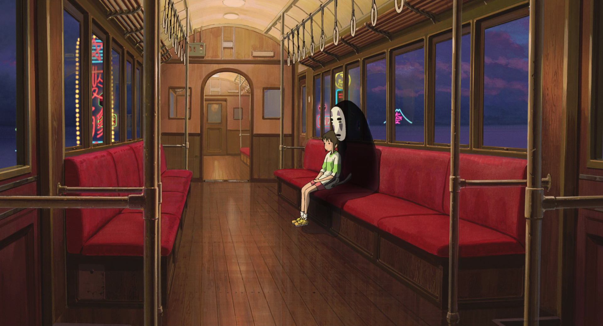 spirited away: Chihiro and No-Face sit in a train at night